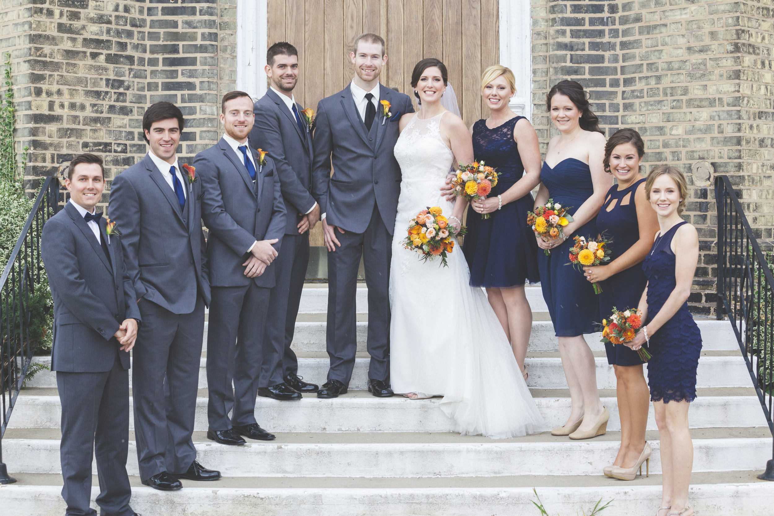 A wedding party photo on the steps of St. Basil Church.
