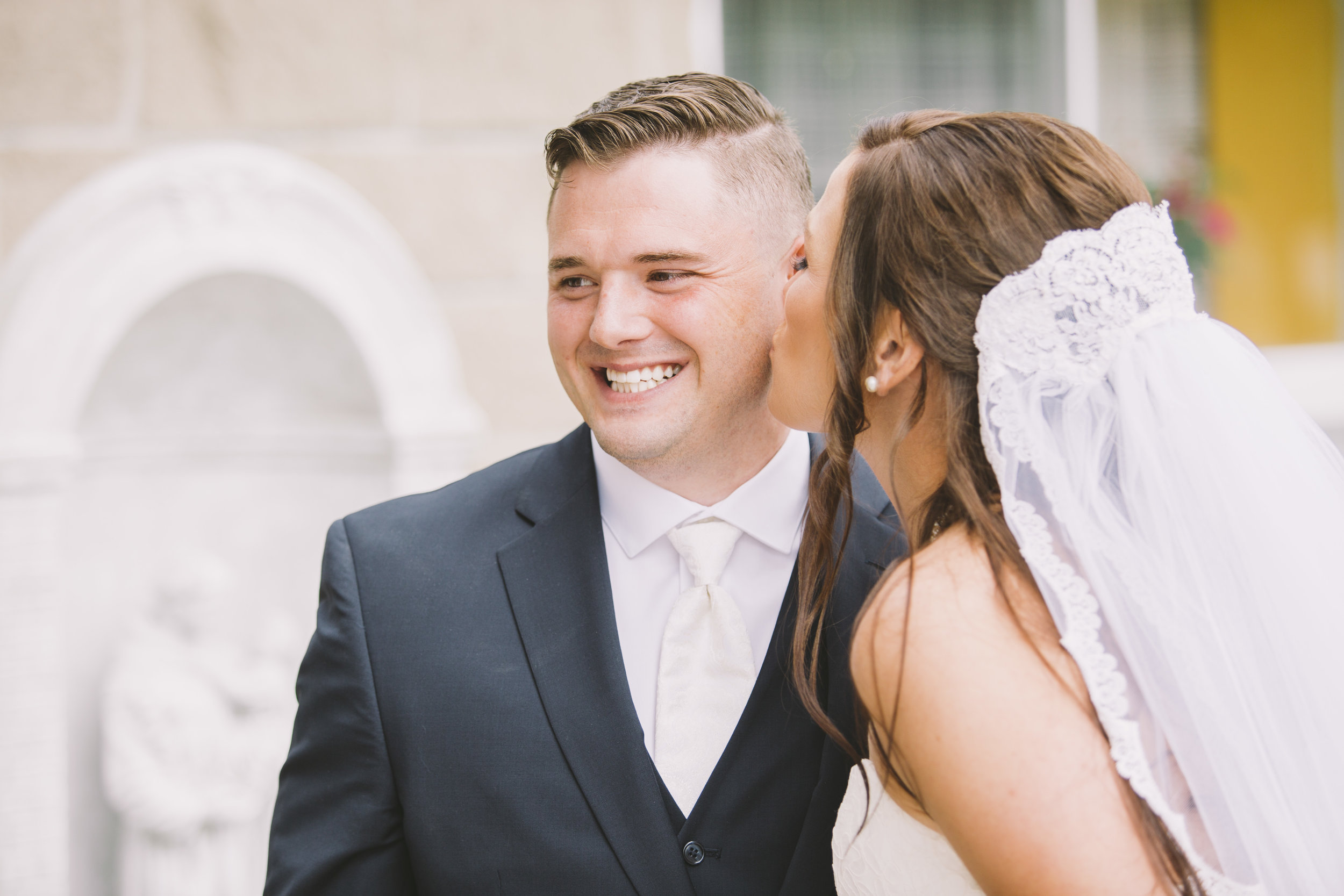 Groom and bride kissing after the ceremony