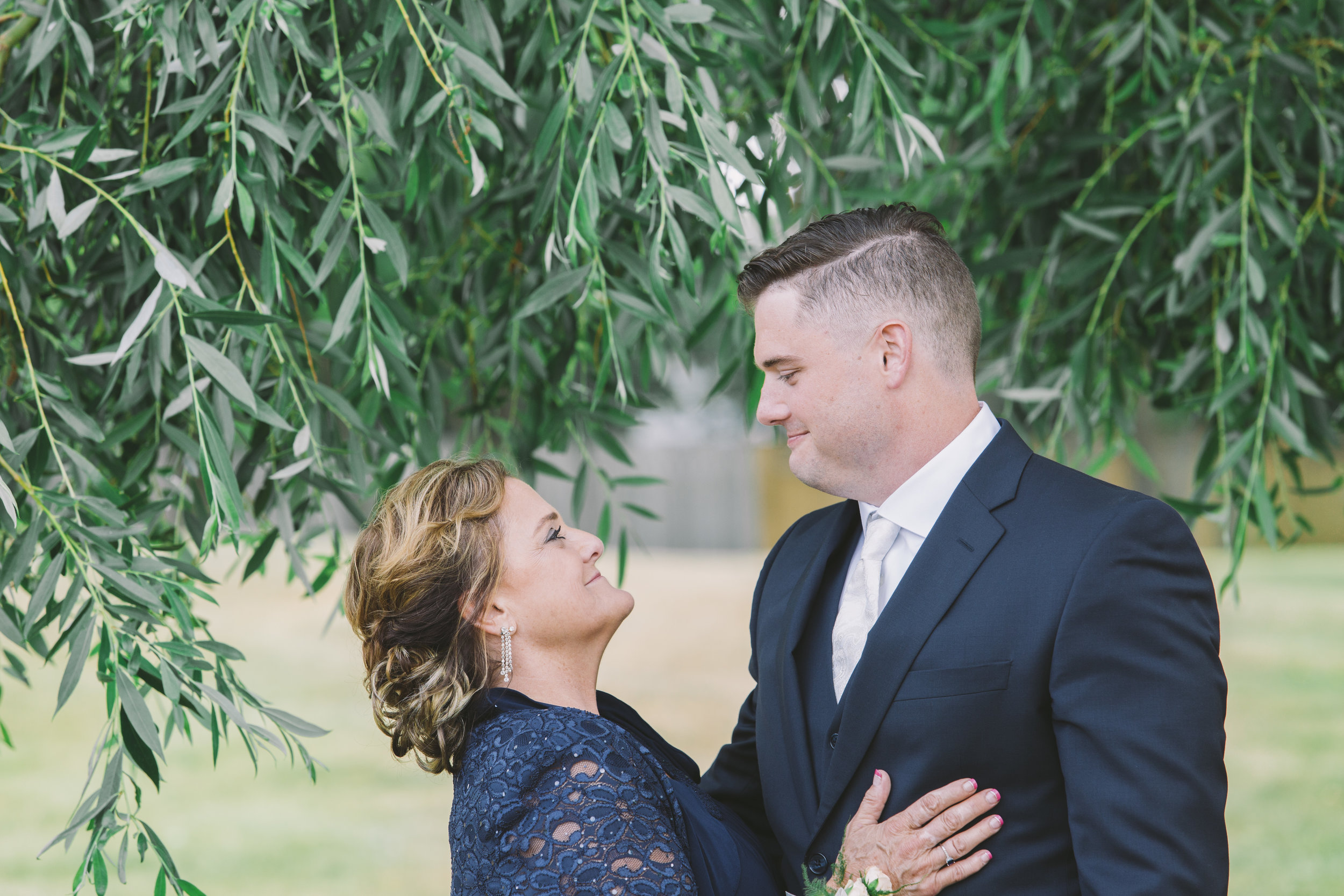mother and son wedding photo