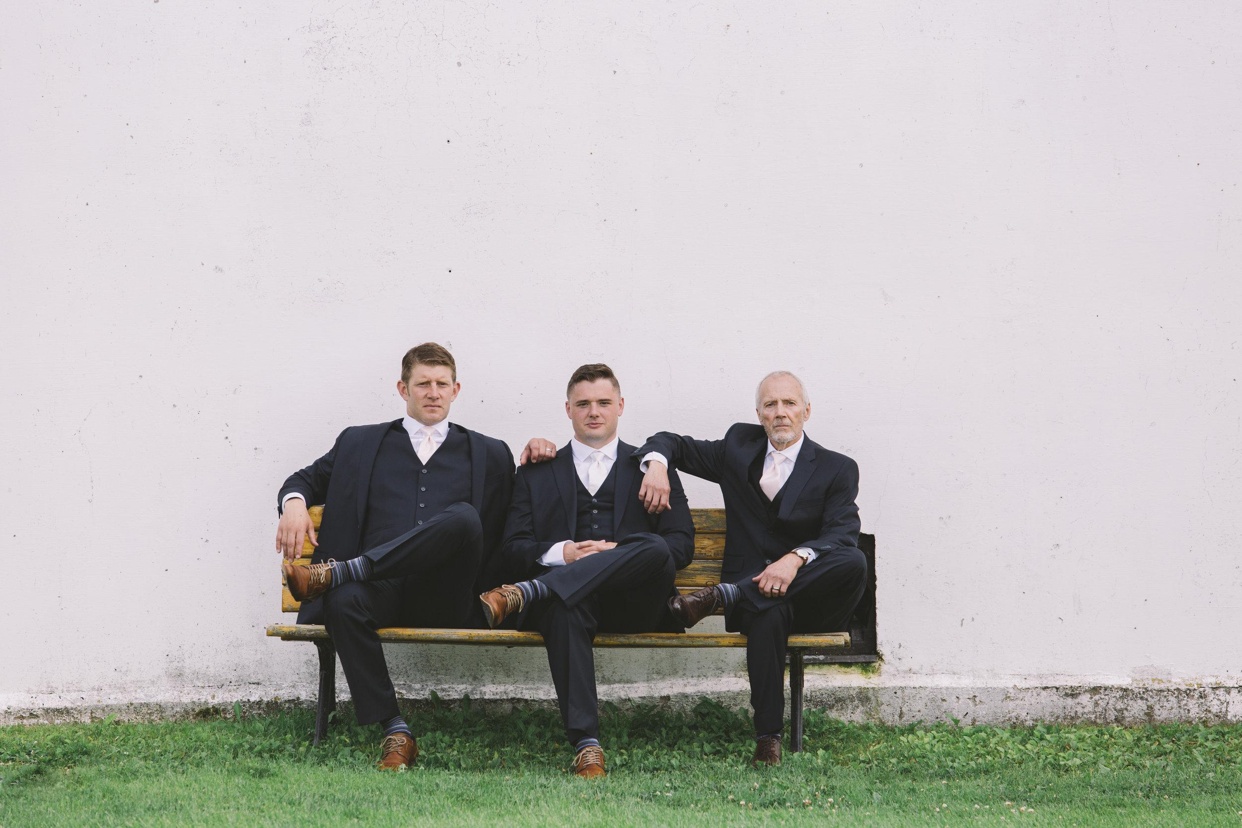 groomsmen hanging out on a bench