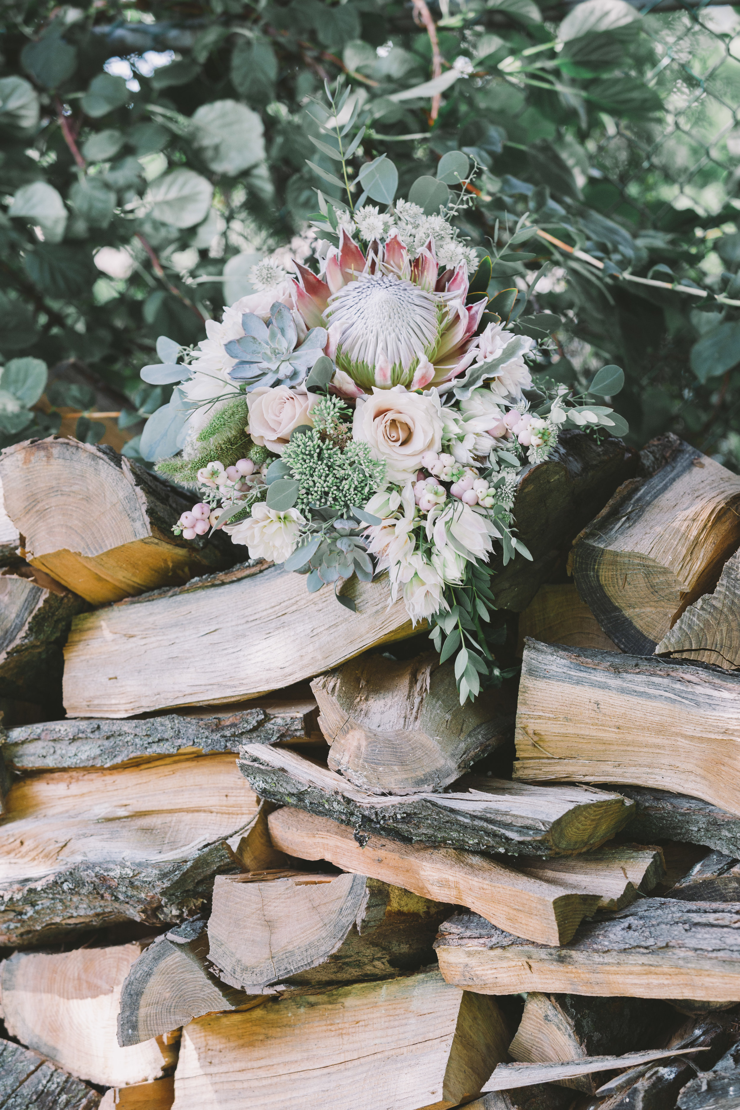 Bridal Bouquet on Wood Pile