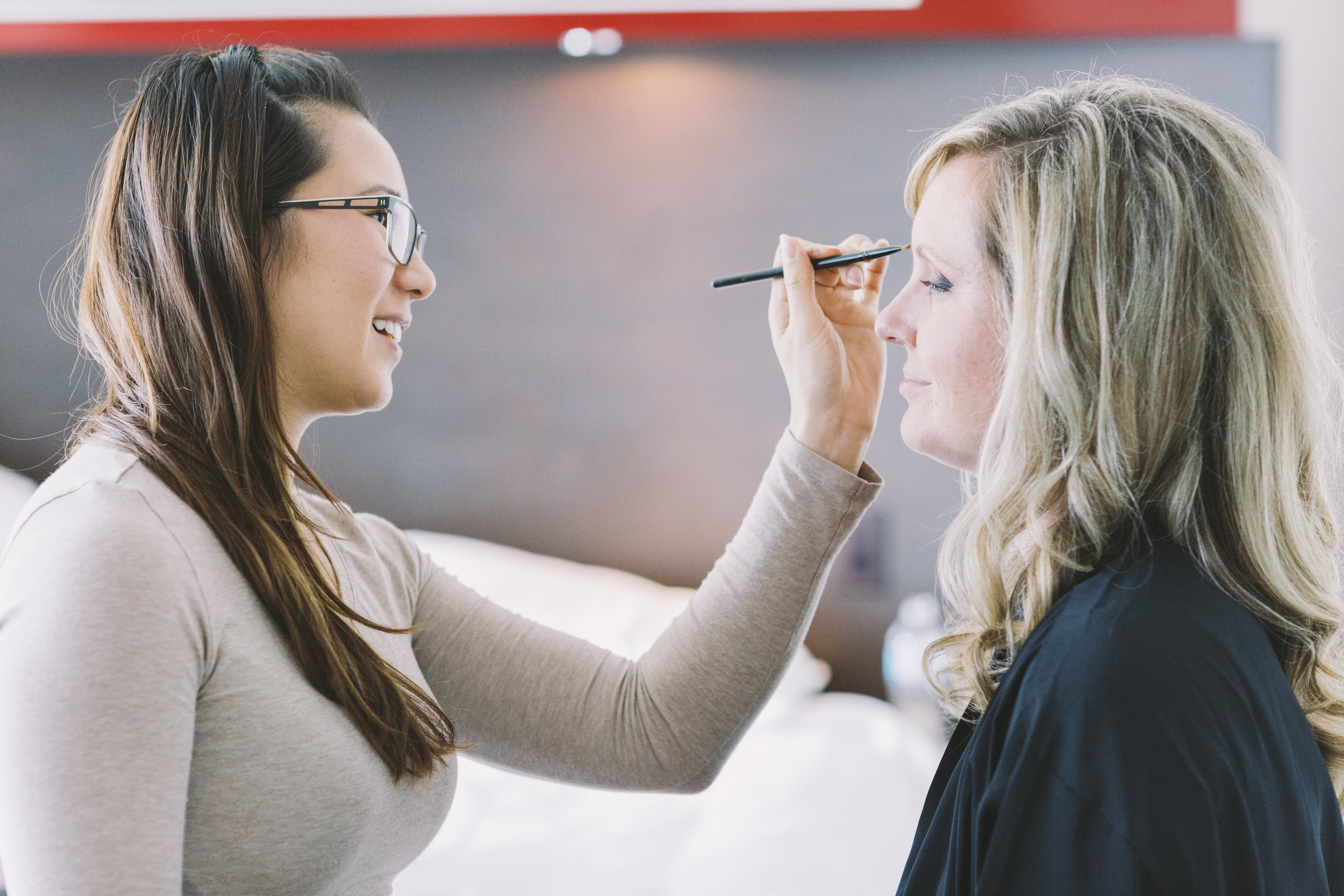 bridesmaid getting her wedding make-up done