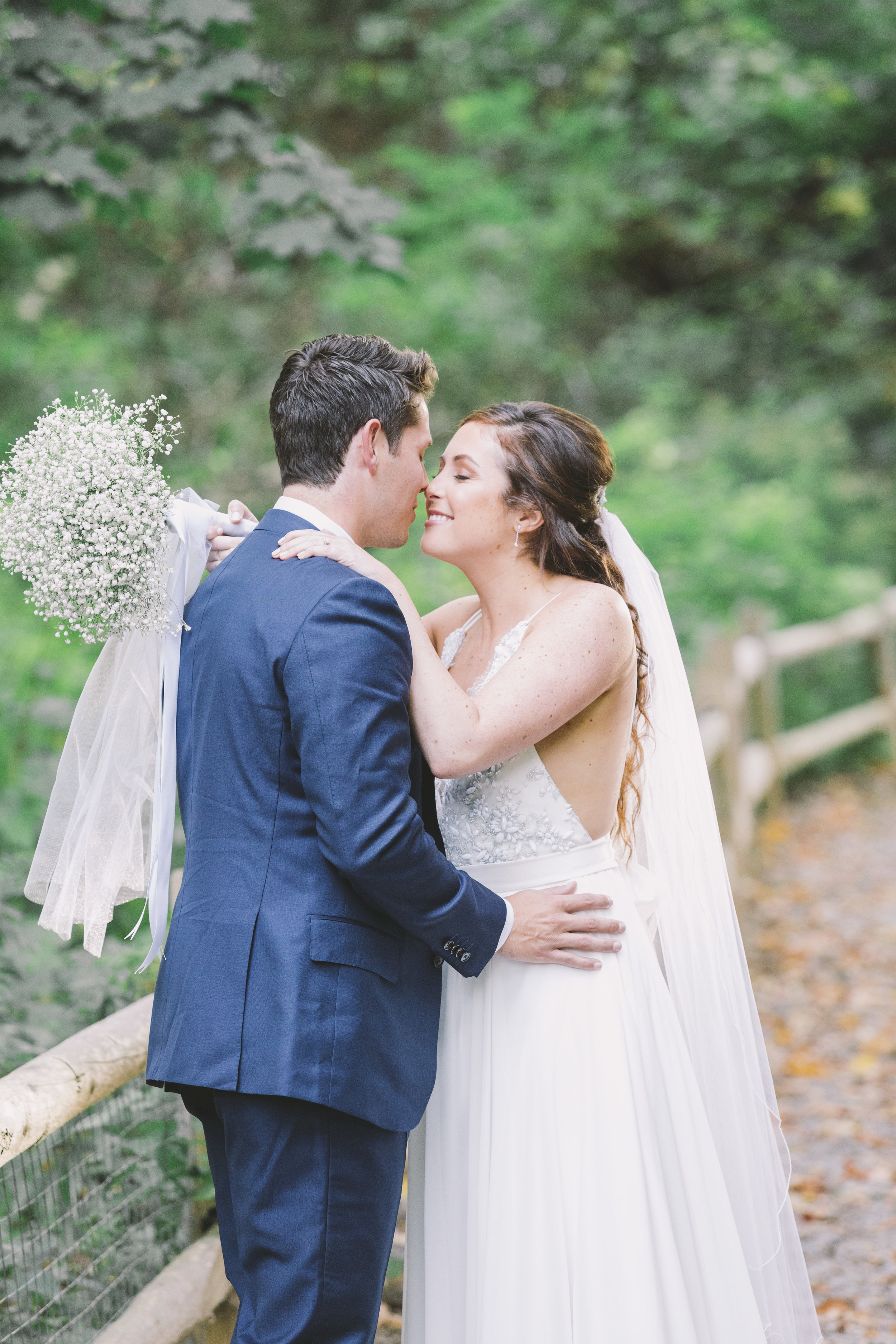 bride and groom kiss after first look