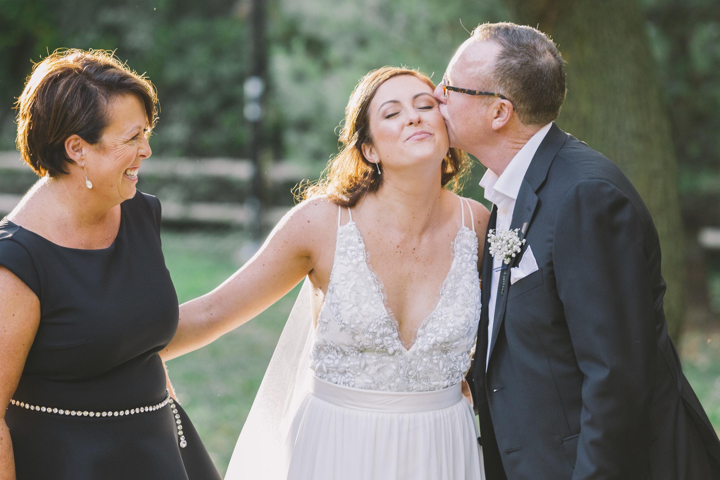 Bride and parents wedding photo.