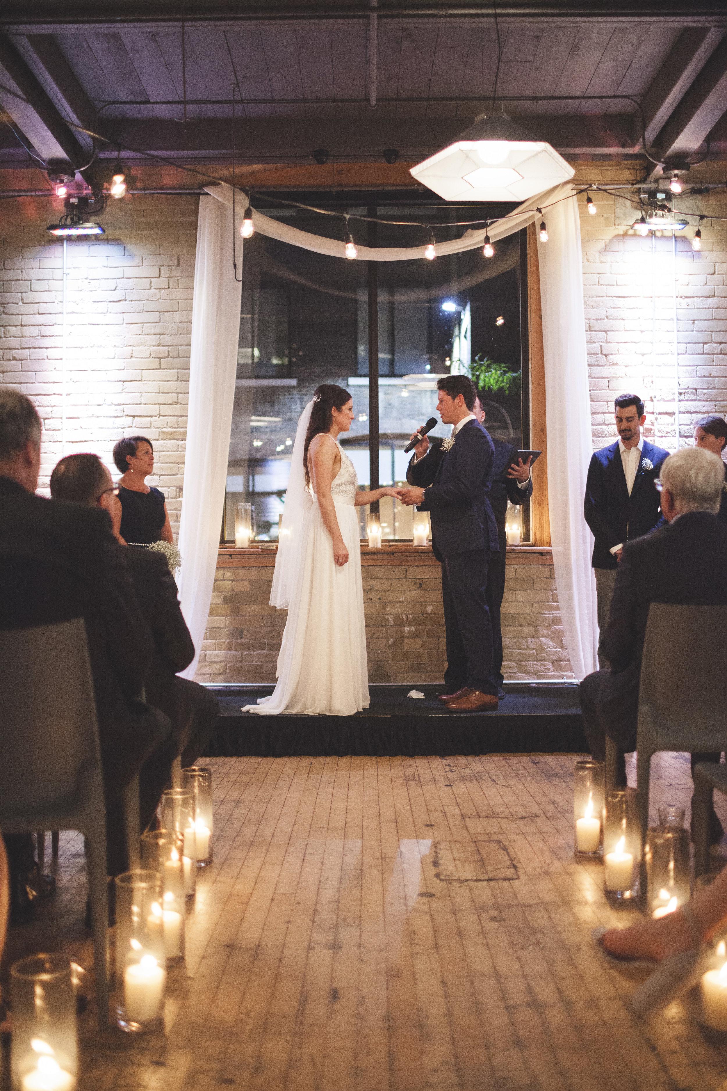 Wedding couple saying their vows.