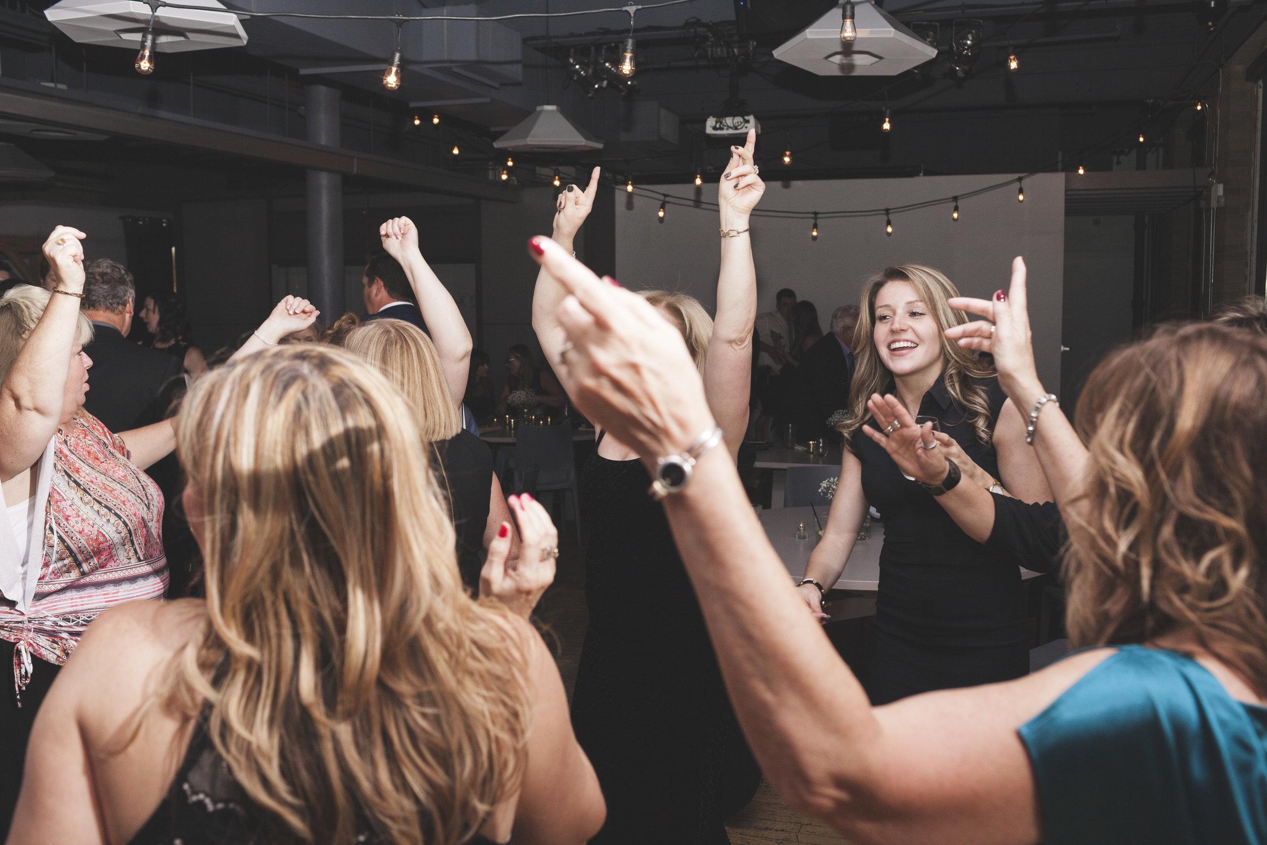 Wedding guests dancing up a storm.