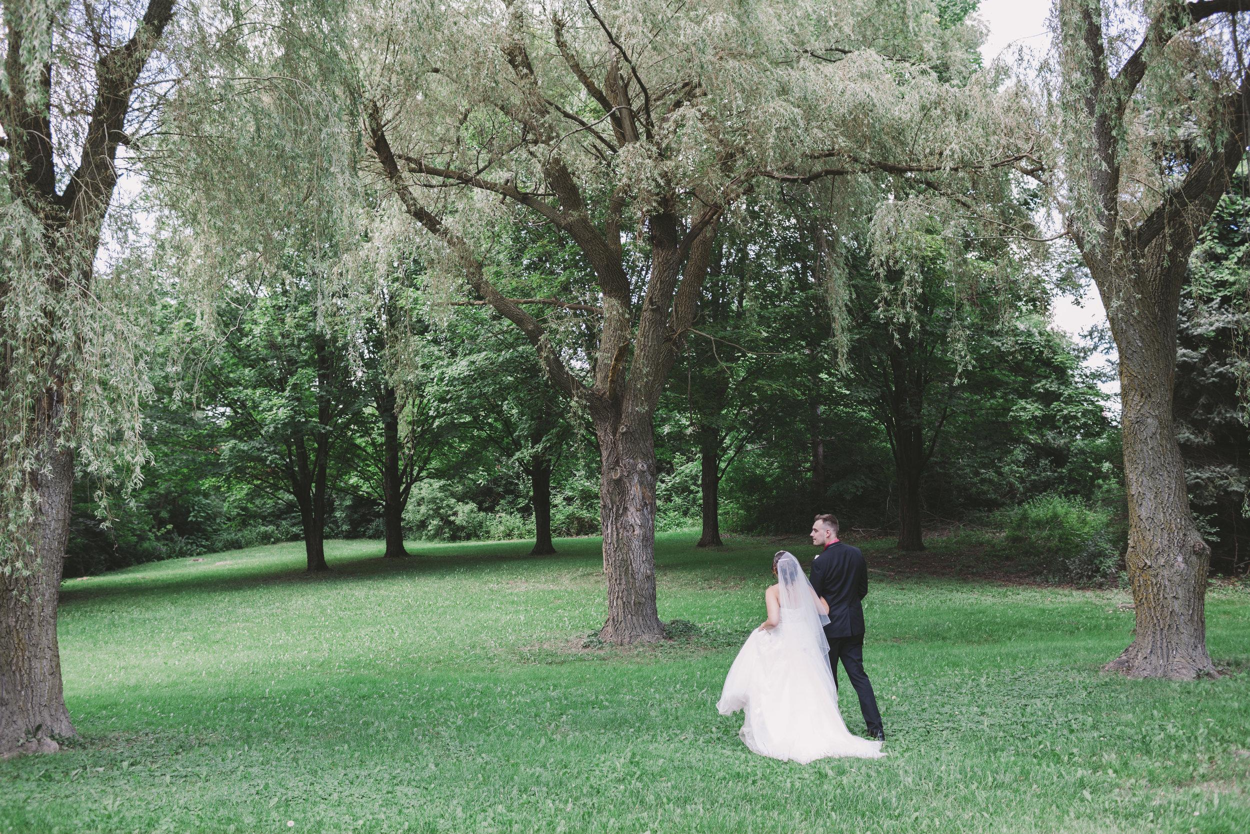 Wedding Couple walking through Glen Shields Park