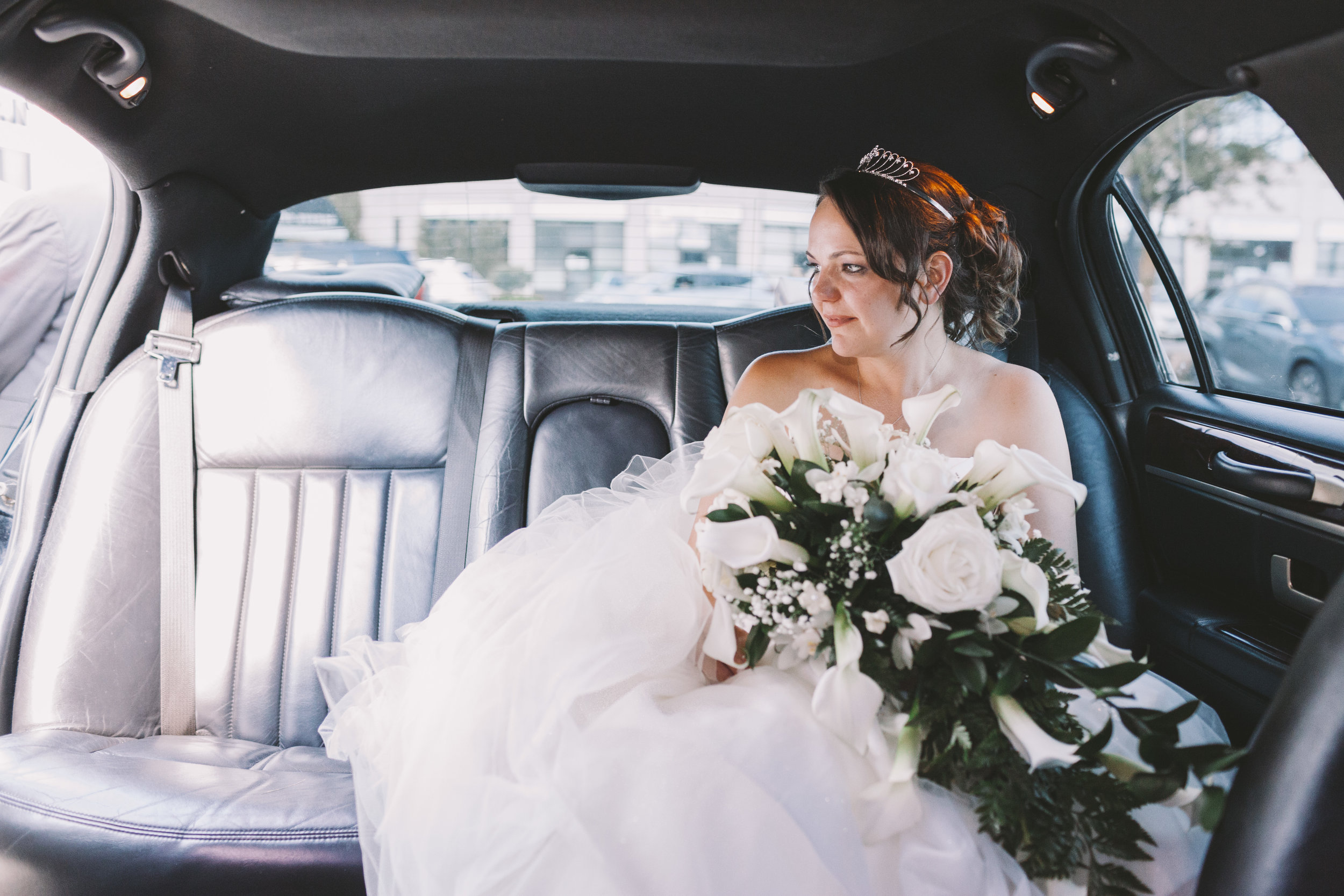 Bride waiting in limo
