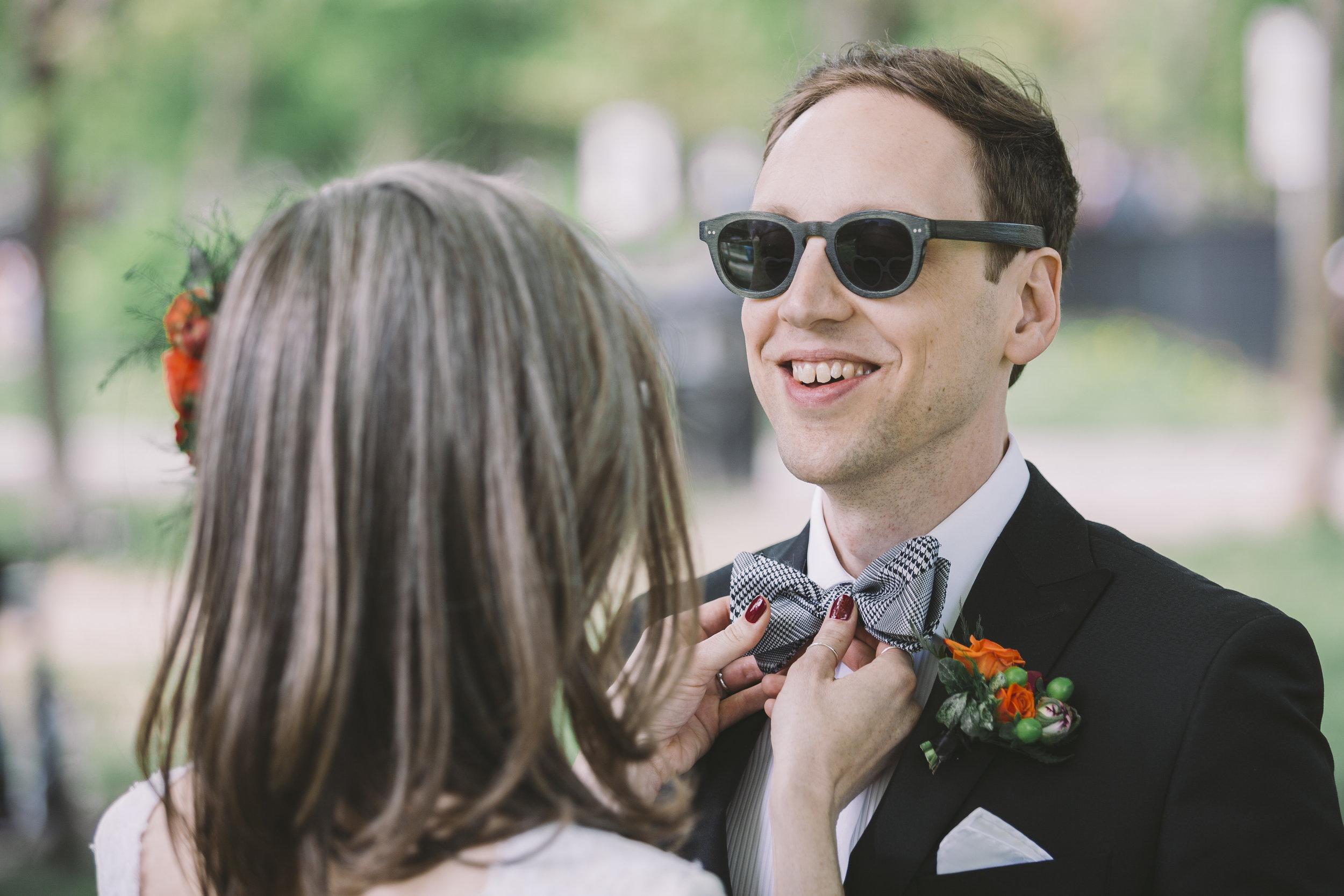 Wedding Couple Adjusting Bowtie in Trinity Bellwoods Park