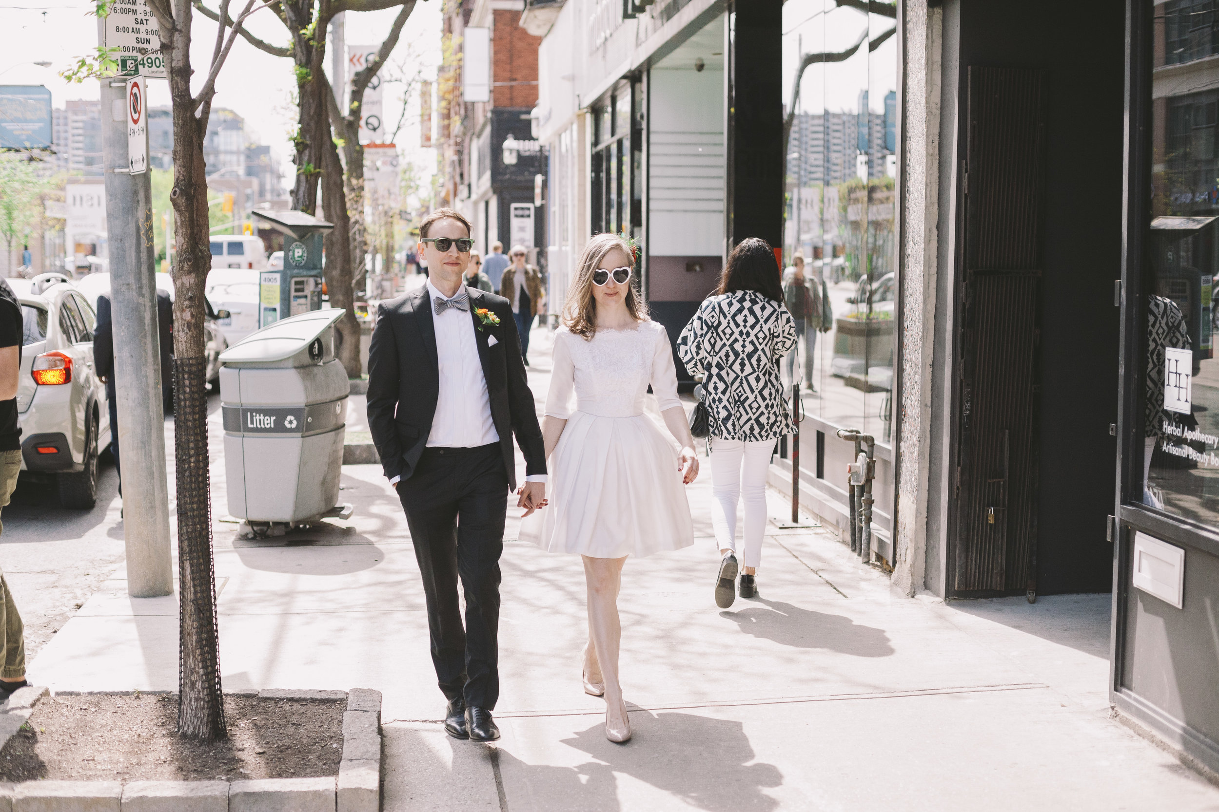 Wedding Couple walking down Queen St.