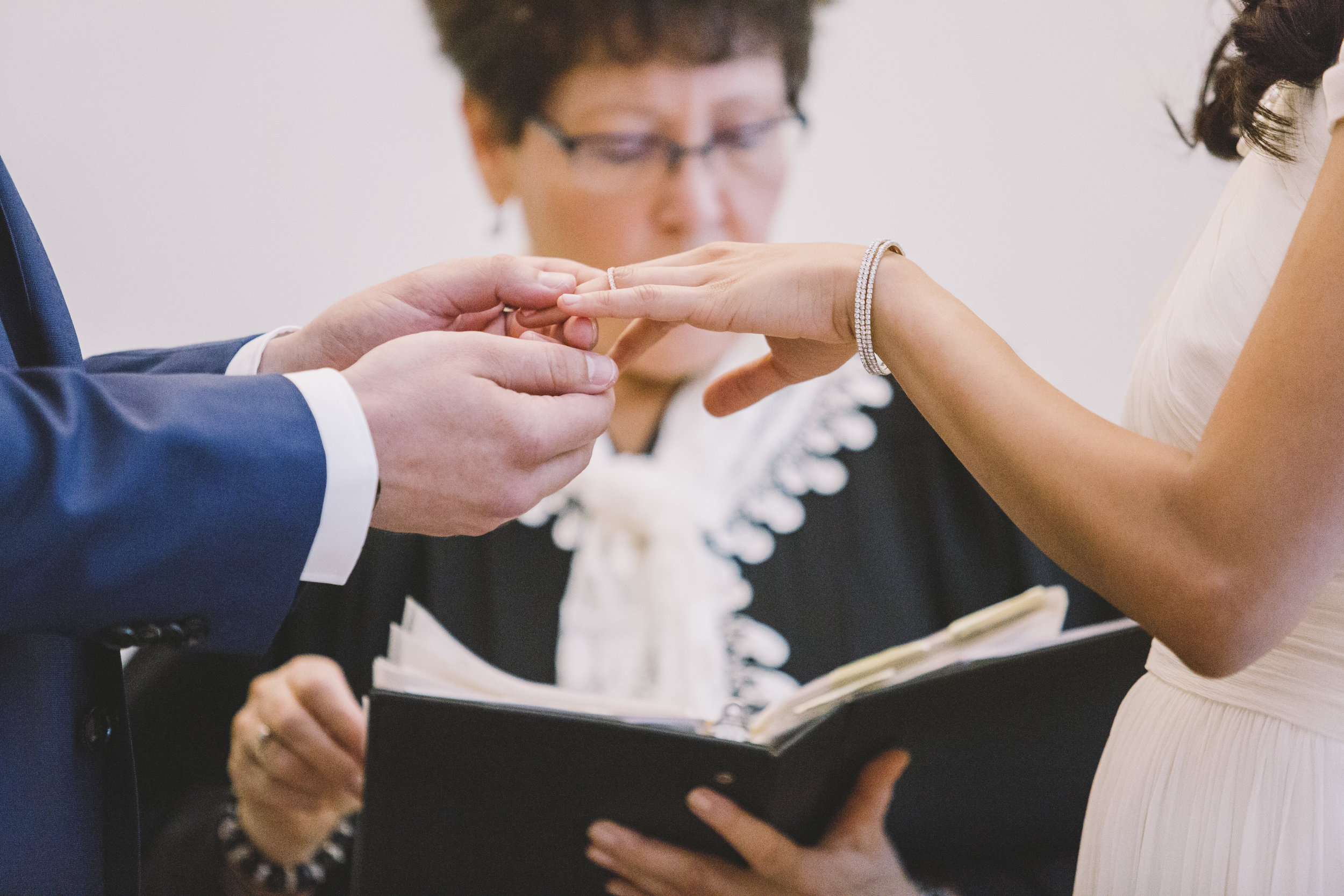 Exchanging the rings at a Toronto City Hall Wedding