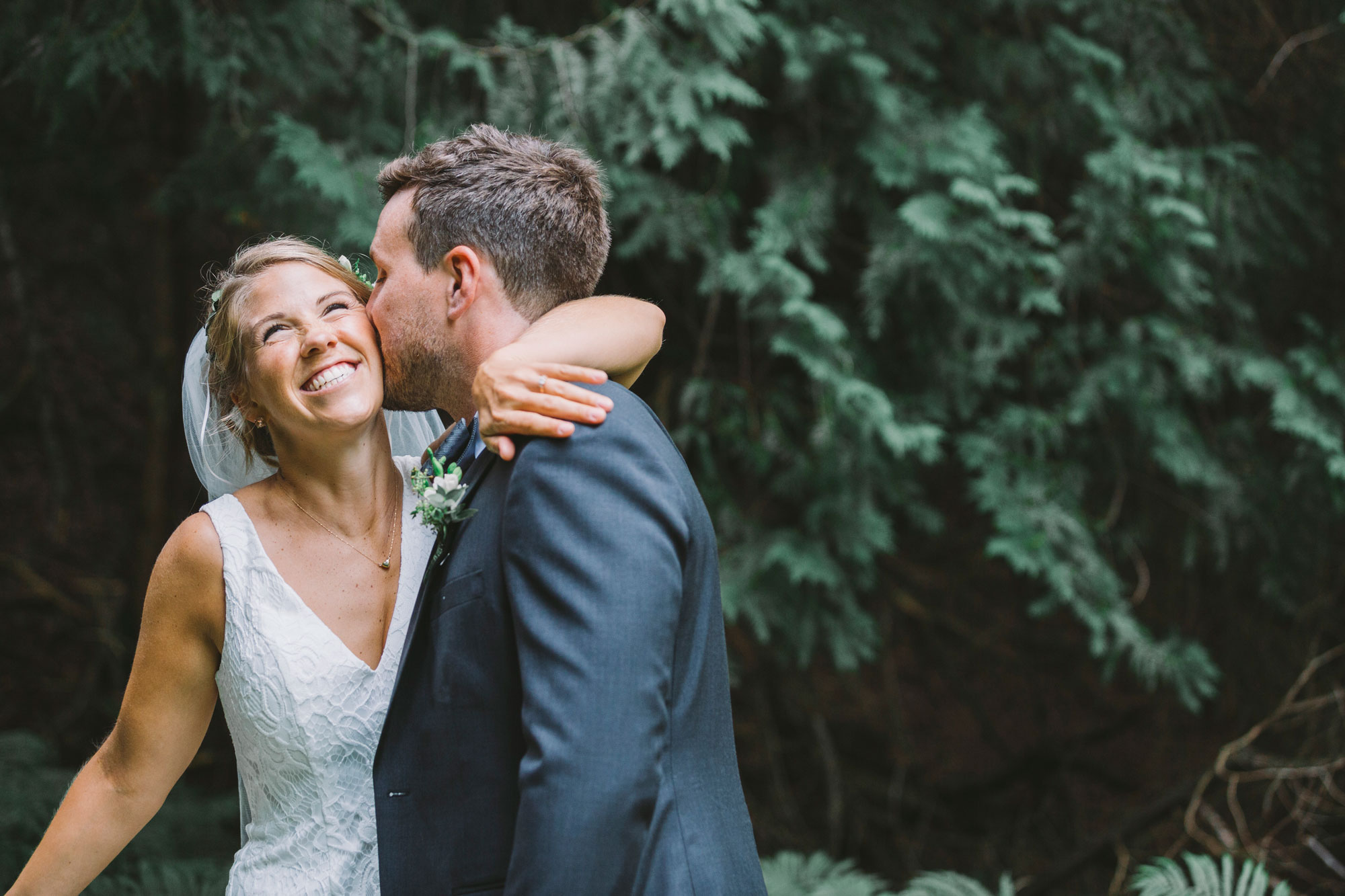 Wedding couple in the woods at Drysdale's Tree Farm