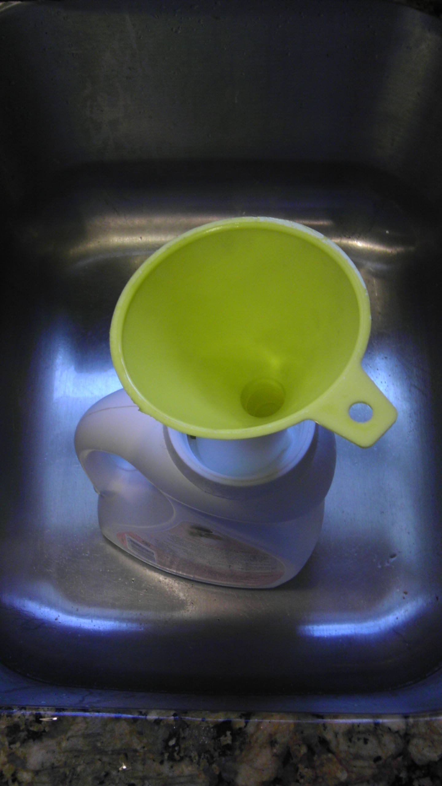 Use a Funnel to Pour the Detergent into containers