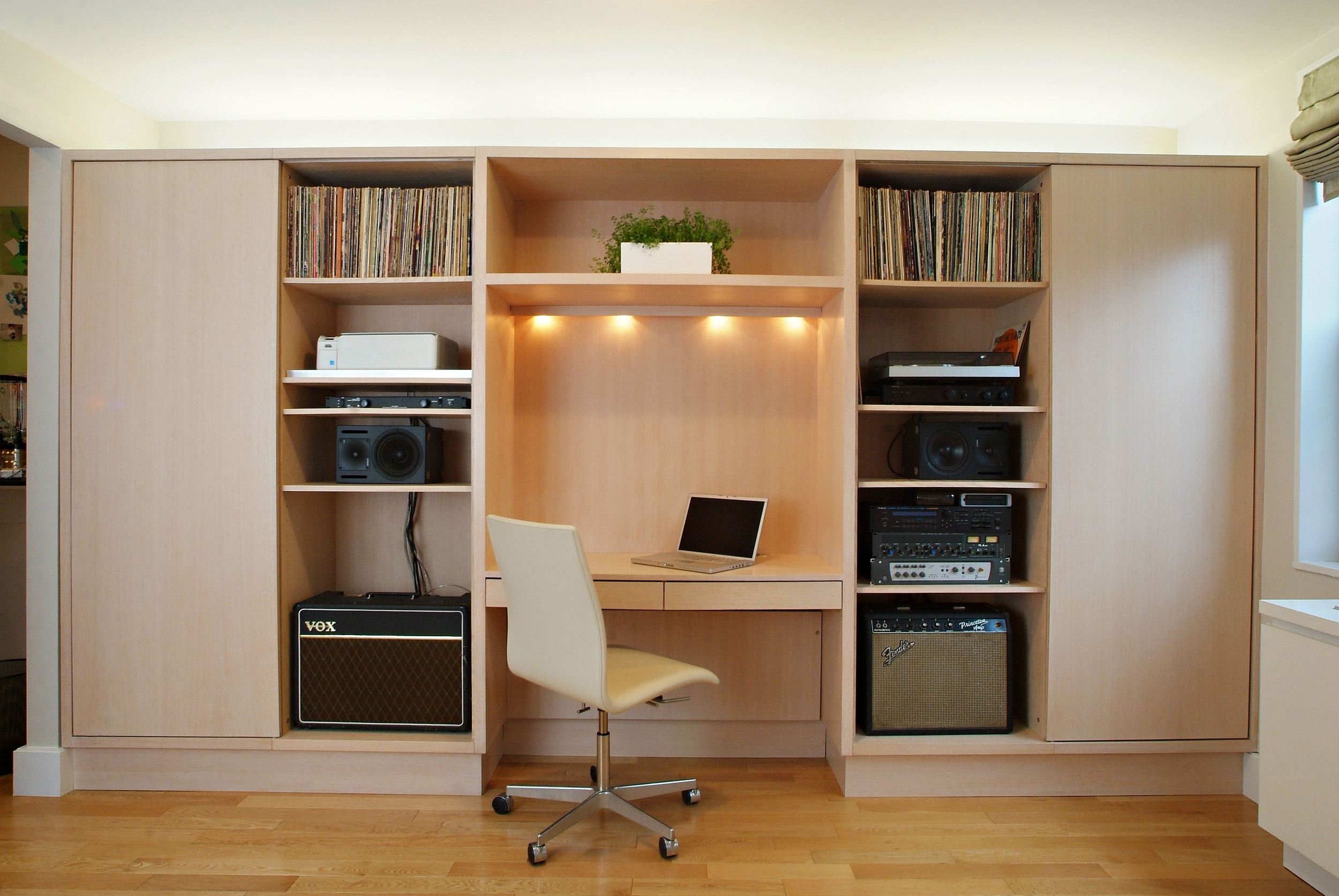 Husband's passion is music. The cabinetry design reveals his musical collection.