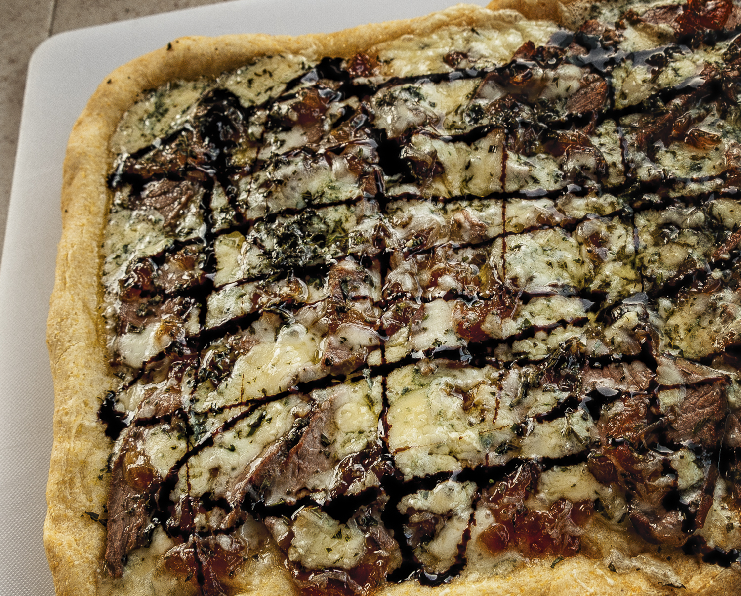 Flank steak, caramelized onion with balsamic fig glaze pizza