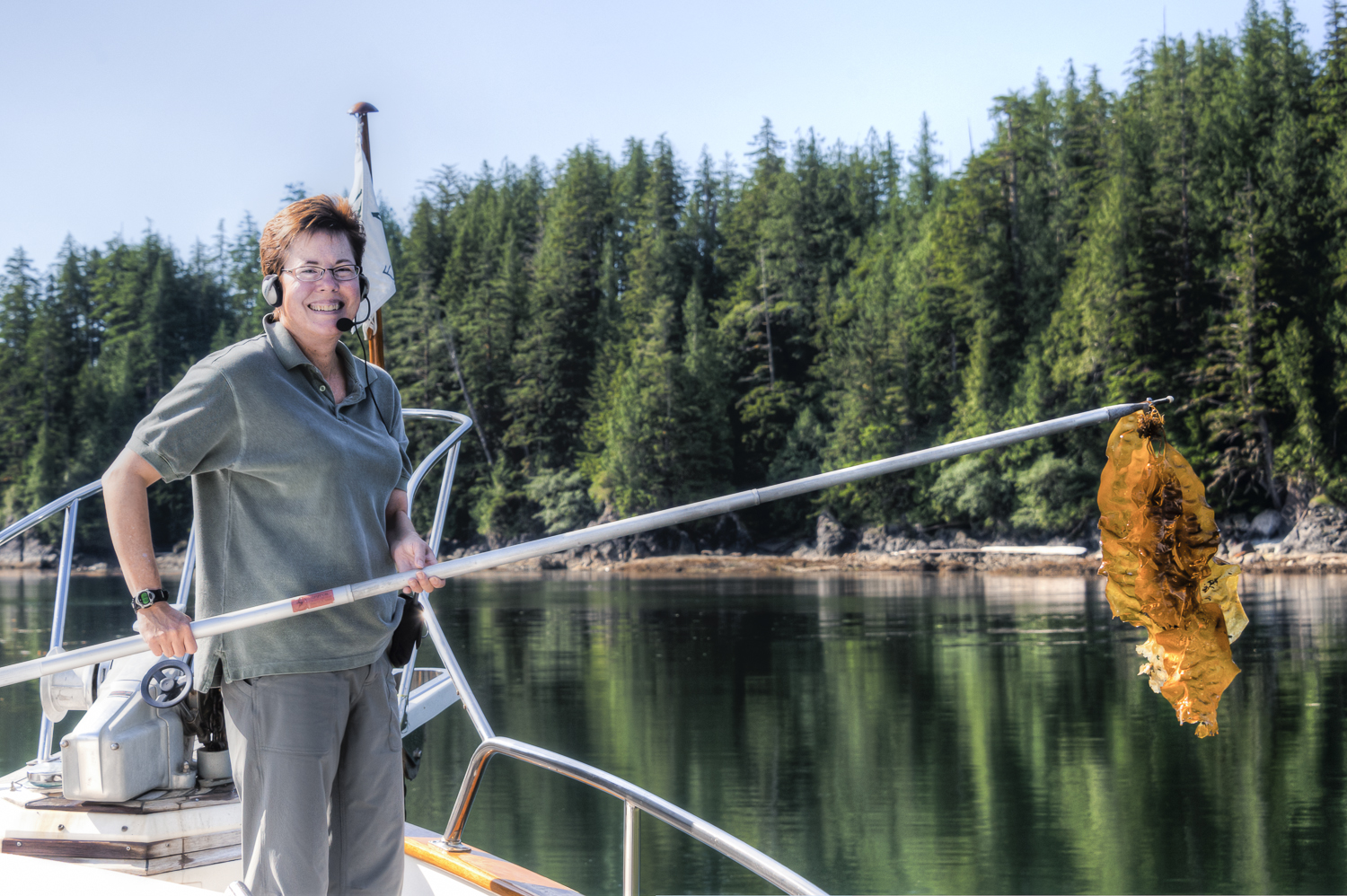 Karen vanquishes the kelp we harvested on our anchor