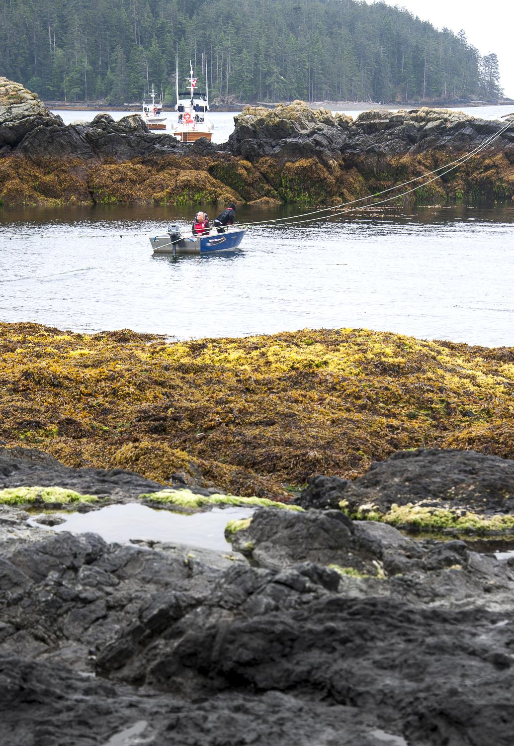 The Watch Keepers bring in supplies from the supply boat in the protected bay
