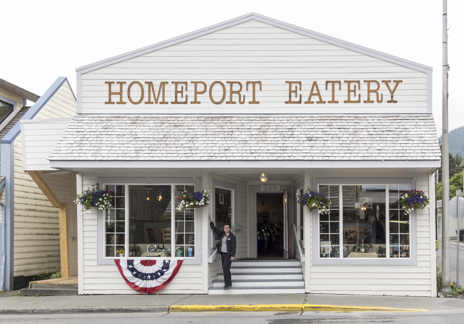 Karen strikes a pose in front of the Homeport Eatery.