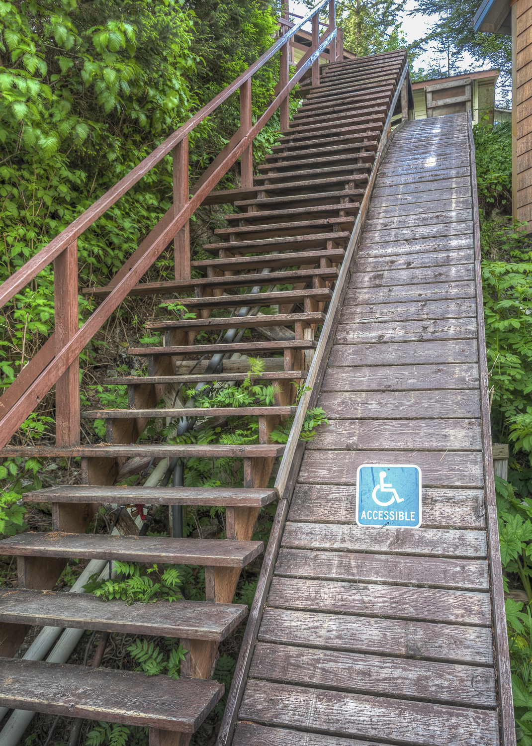 """A little Elfin Cove humor. A lot of the """"uphill"""" residences have a cart track alongside the stairs for getting groceries home."""