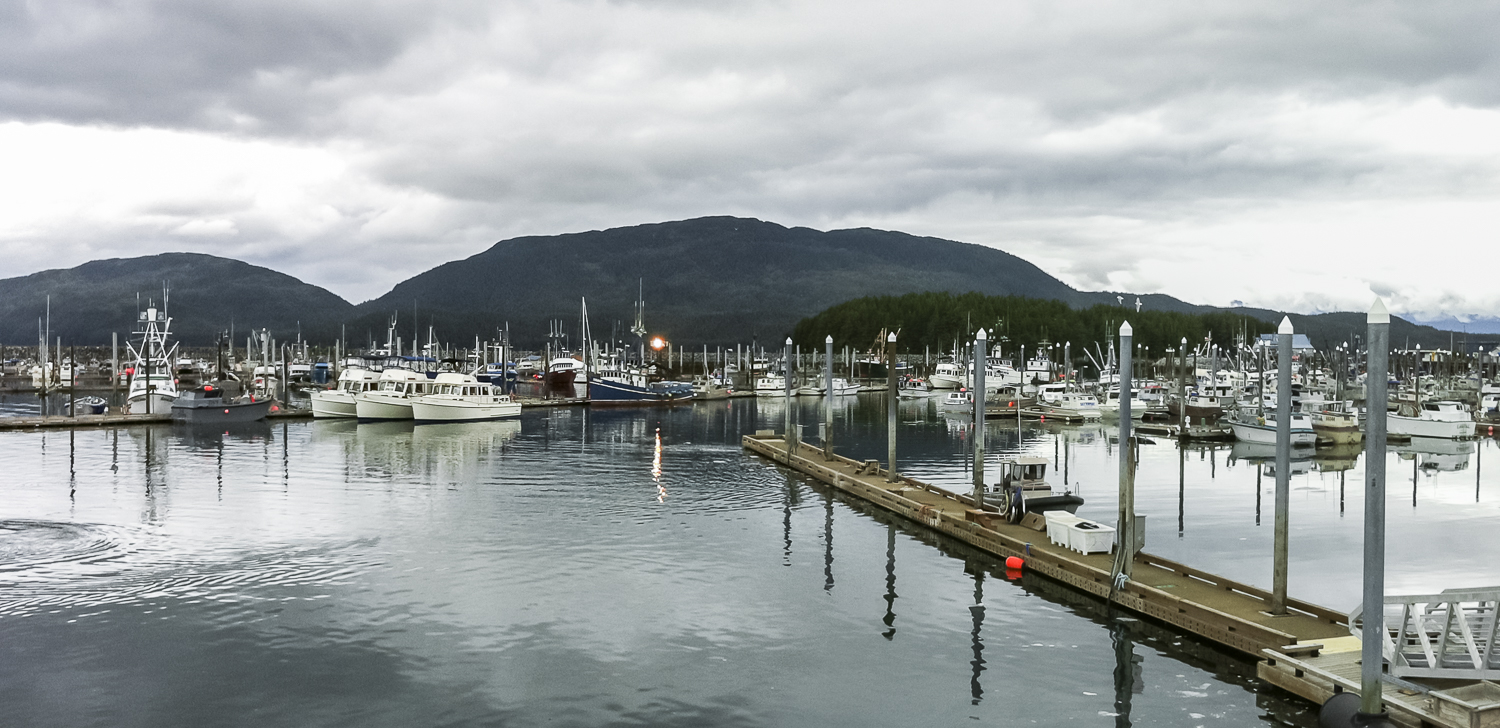 """The """"pleasure yachts"""" stand out in the working harbor of Cordova"""
