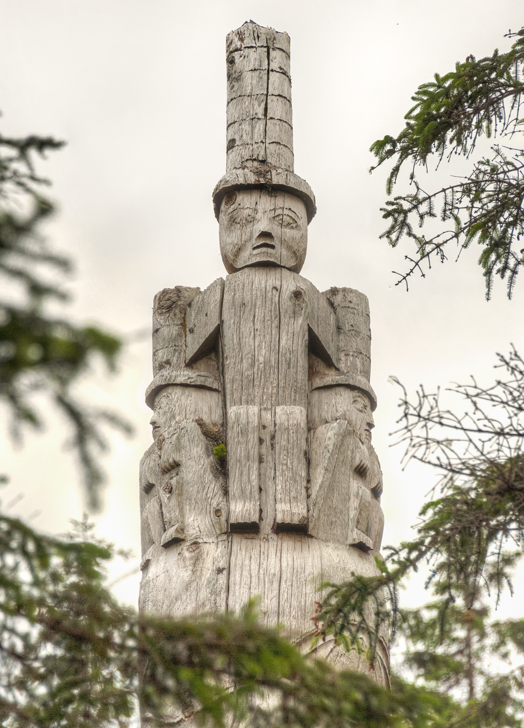 A not so traditional totem. Have the guides tell you why this totem is topped with this figure.