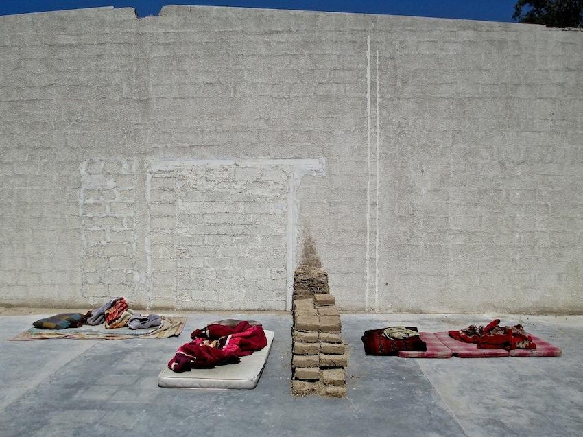 Imagesof the wall and the wall with tushaksby Amanullah Mojadidi.Imagesof the demolition by Nilo O. Pantig, Jr.