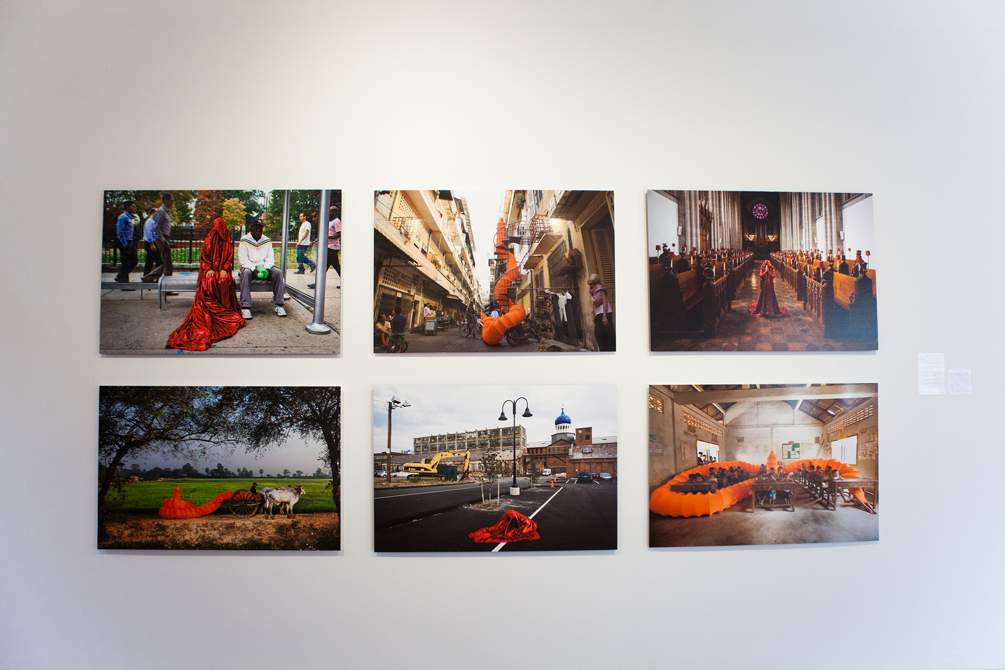"Installation view of Anida Yoeu Ali's ""Red Chador"" series"