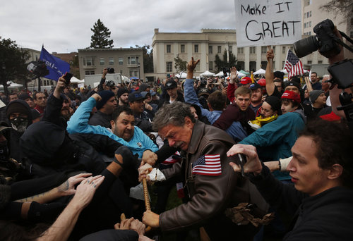 Leah Millis,  Tom Condon of San Francisco, center, a Trump supporter, becomes entangled in the center of a fight after attempting to push anti-fascist protesters back with his cane during a Pro-President Donald Trump rally and march at the Martin Luther King Jr. Civic Center park March 4, 2017 in Berkeley, Calif.