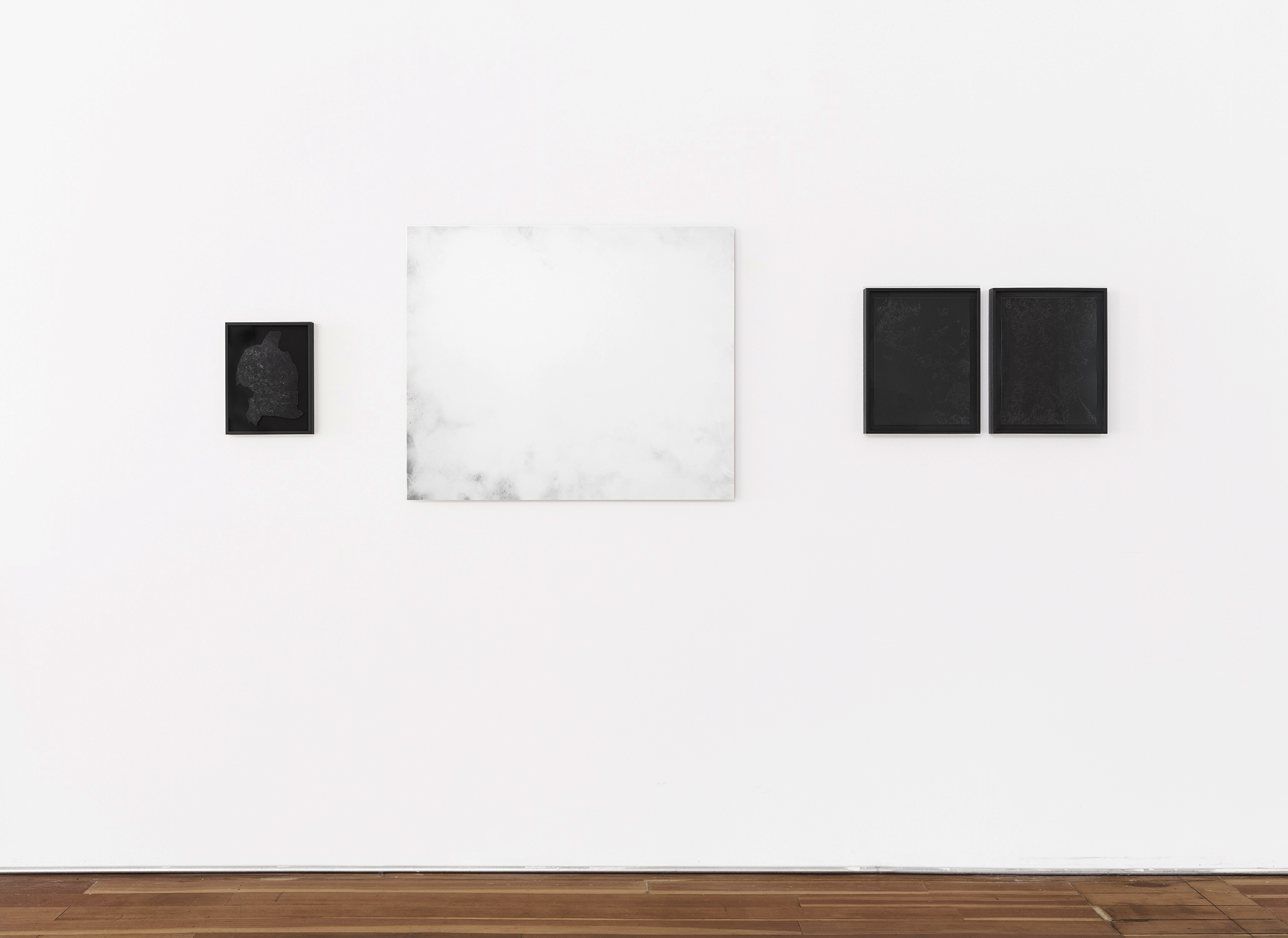 Jennifer Brandon's installation of  Equivalent I (middle),  Andréanne Michon's installation of  Disappearing Landscapes  (right) and  Embossing with Transfer 1  (left).