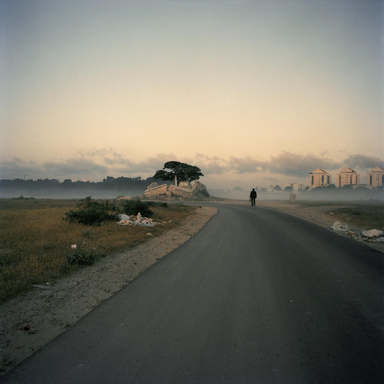 Hadera; migrant worker walking towards the town, 2012