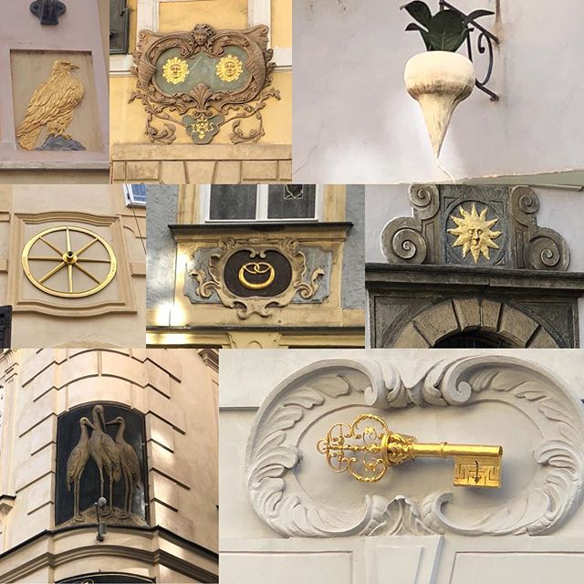 In Prague they use to name their houses with an image of their industry for their address, instead of numbers. The 3 storks represent the midwife, the golden pretzel...the baker, the white radish.. the greengrocer and so on. Sometimes for a home it was just a sun or two stars