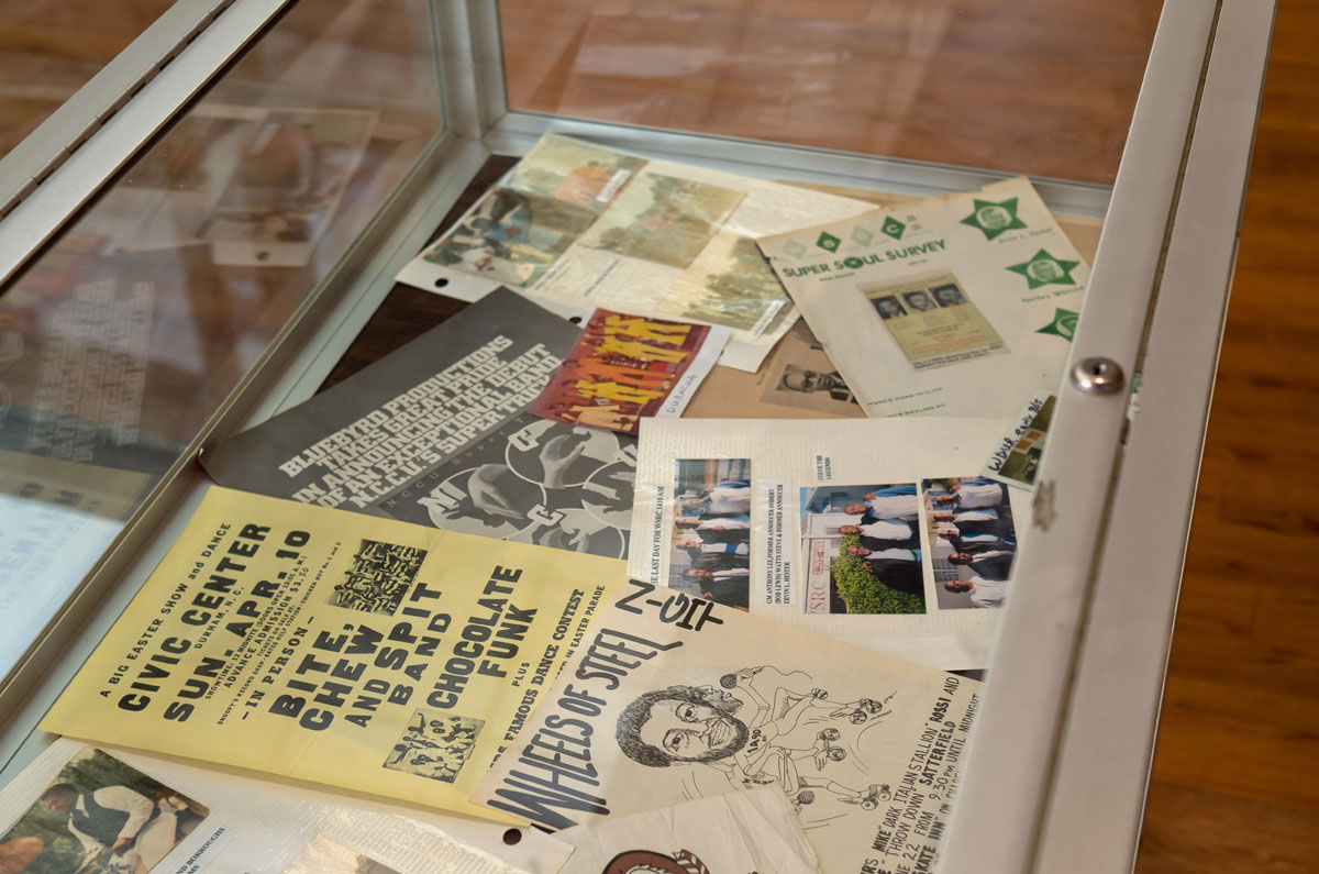 Artifacts included flyers, photos, and other memorabilia.
