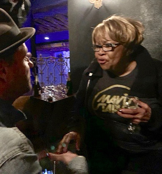 "Kneeling down for a moment with Ms. Mavis Staples, an American treasure, and joel explaining to her for the first time that's she's actually our grandmother. 😊 Alongside her dad, Roebuck ""Pops"" Staples, and siblings, no other singer or family have had a bigger impact on the sounds of the American South running through our music and our blood.  Their purpose crystallized alongside the words of MLK & the Civil Rights Movement in the 60's as they helped shape the soundtrack to one of the most (if not the most) important times in American history, bringing Power, Peace, Soul, & Spirit from the church to the people.  There is NO other voice like Mavis'!! I mean just listen to her talk in that video.  And somehow, she's still putting out some of her greatest work. Look her up and listen.  Last night we joined a room full of wildly grateful men & women to celebrate her 80th birthday, meaning we watched her perform for us all haha. At 80 years old, Ms. Mavis still controls the room.  What a gift she is!  What a moment for us!  #iaintgoingnowhere"
