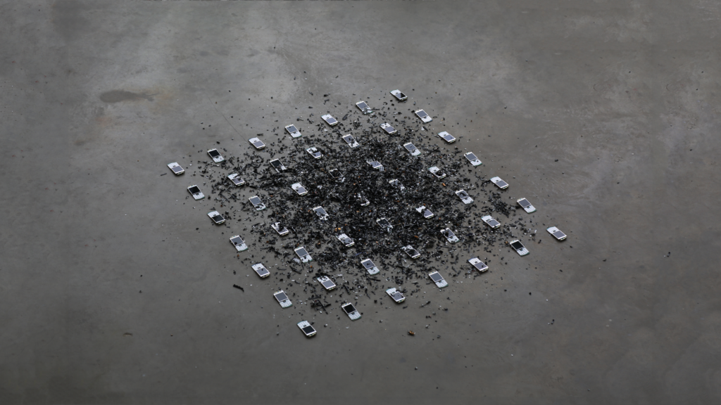 Nathan Caldecott, Pearl Chorus, 2017. 49 shredded Blackberry Pearl 8110 camera phones connected through an encrypted network. 120 x 120cm installation.