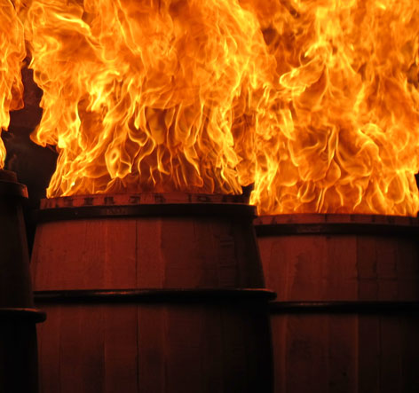 Charring Bourbon Barrels-the inside of the barrel is set on fire to create a black charred layer