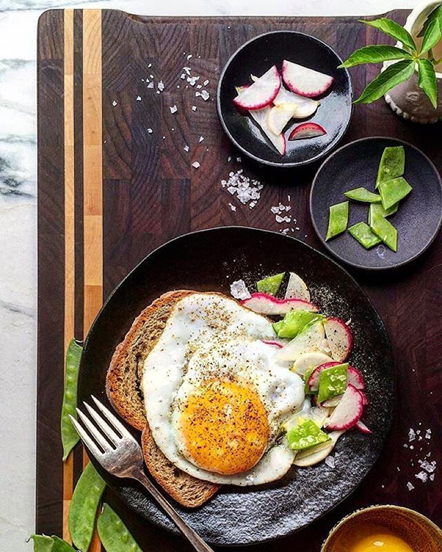 Olive oil fried duck egg with gluten free rye on this beautiful wood board from @mastrocompany 📷: @feedmedearly
