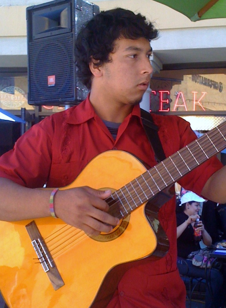 Josue performing at a Summer Concerts