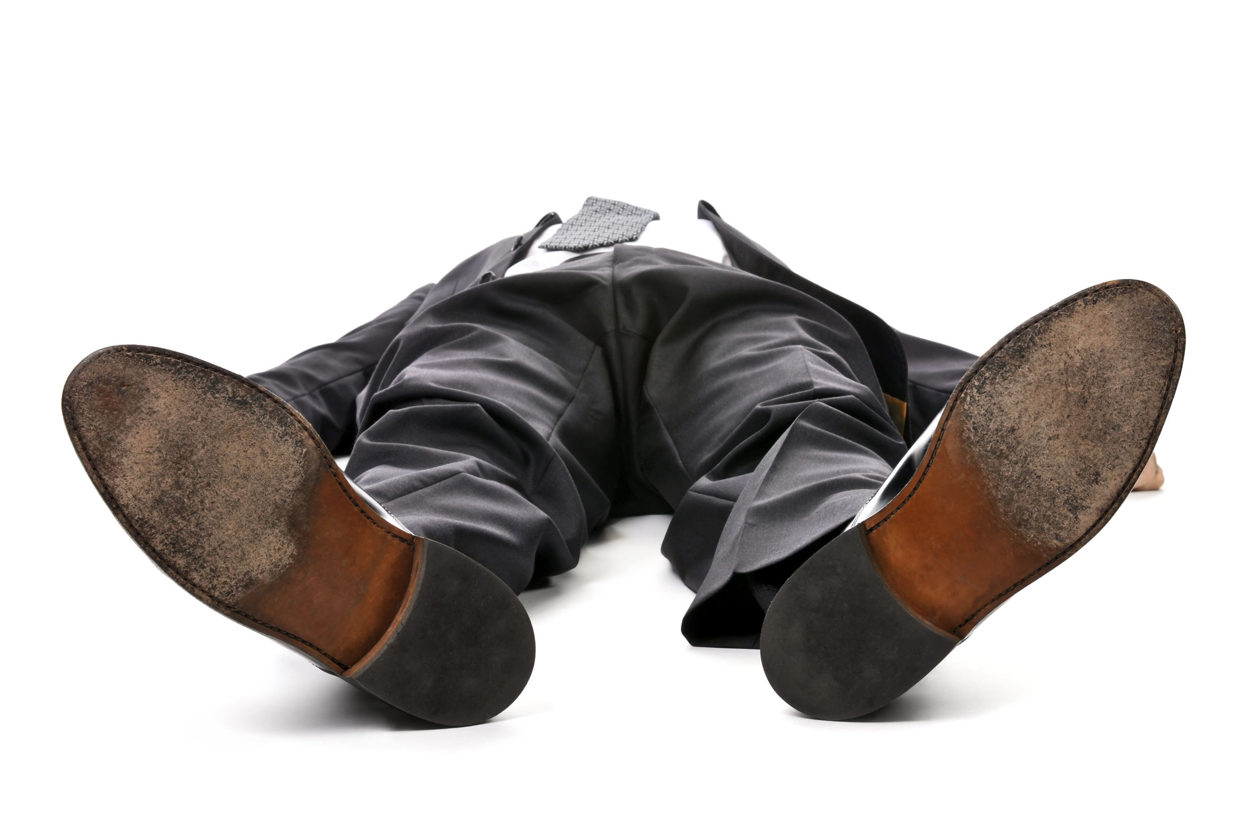 man suit lying down tired exhausted.jpg