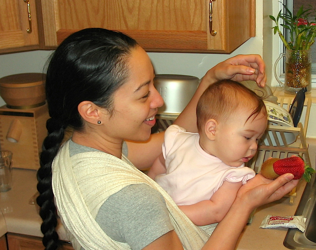 Florida 2004. Teaching baby Heistheway about what I was preparing in the kitchen
