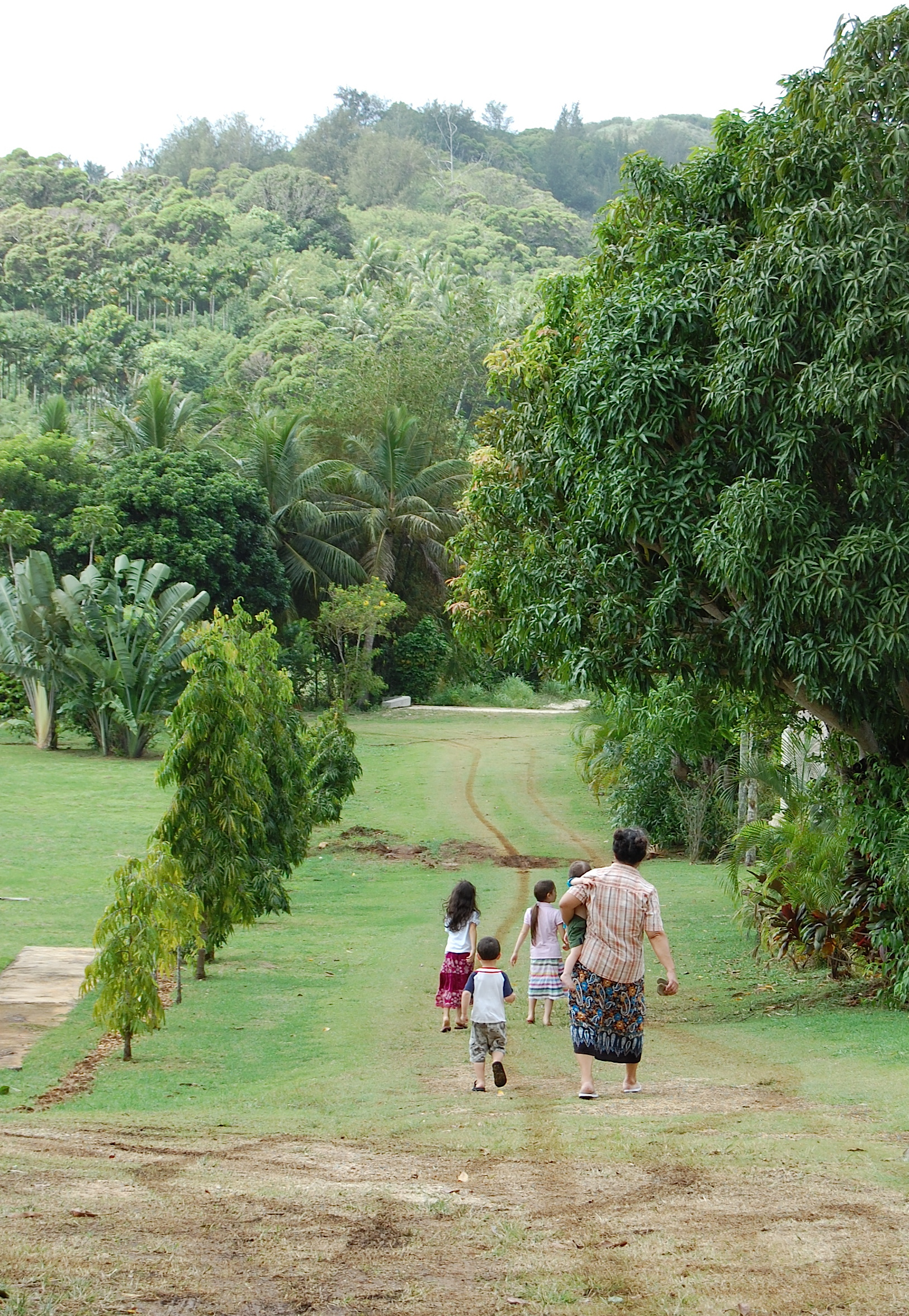2011 - Mom walking with our children in Saipan while we looked for grapefruit and pomegranates while Tim was training in the states
