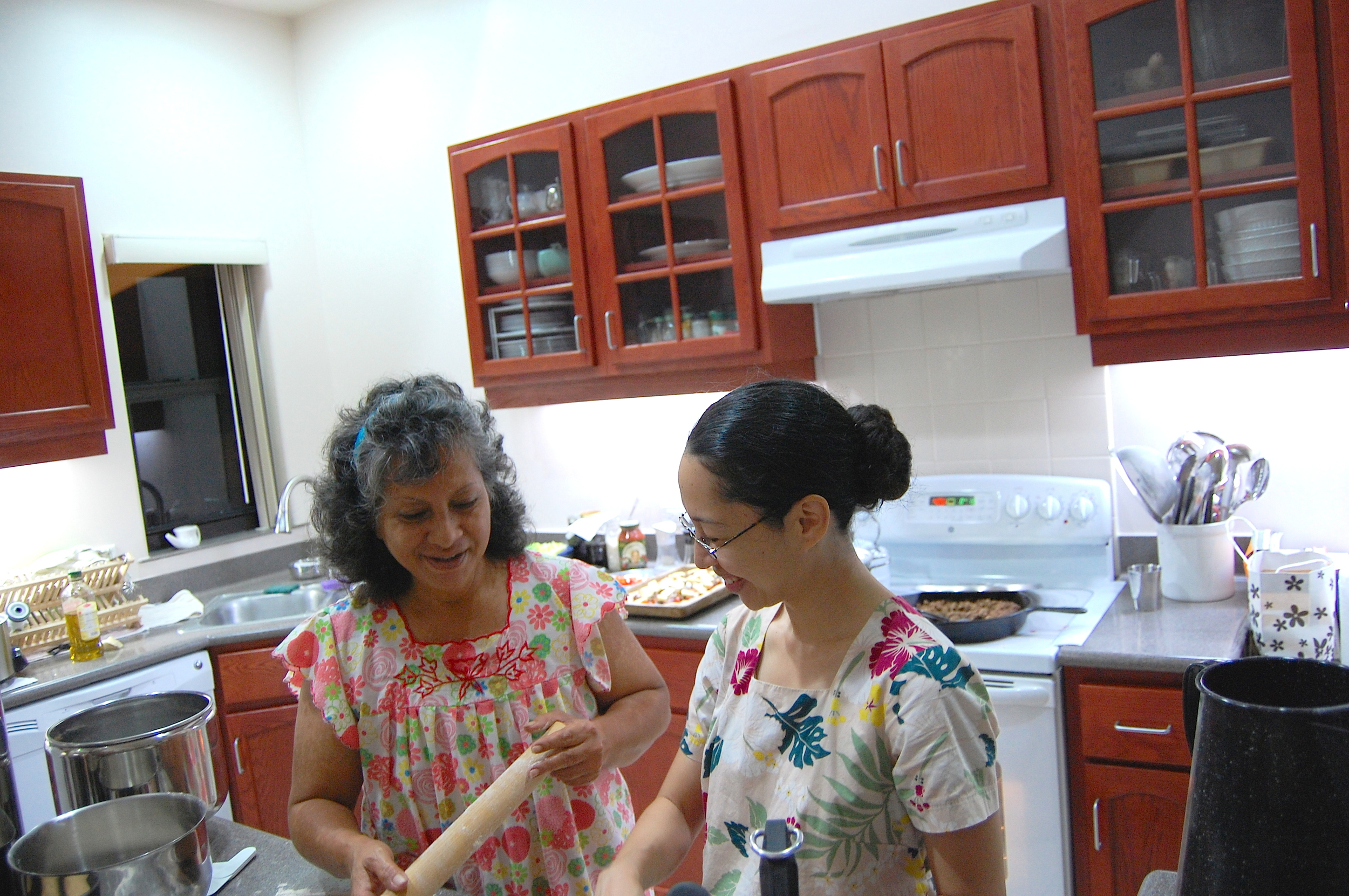Guam 2012. I grew up with maids and had to teach myself how to cook after I got married. Here Mom wanted me to teach her how to make organic pizza from scratch from flour we milled.