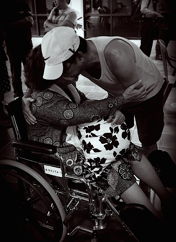 February 2013. Dad says goodbye to Mom at the Saipan airport as she leaves for the Philippines for a diagnosis and her first chemo treatment