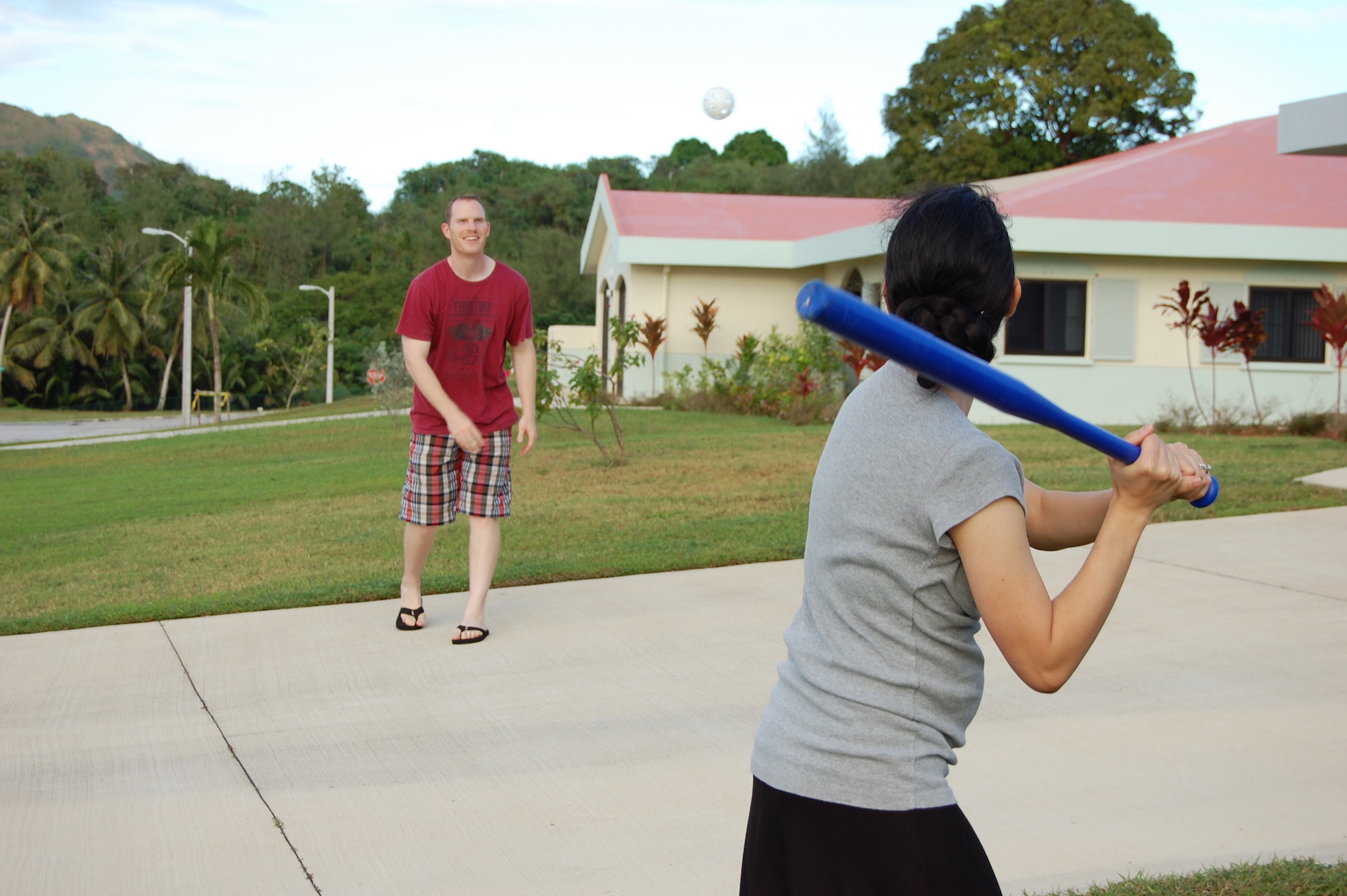 Tim and Franicia playing baseball together and with the children