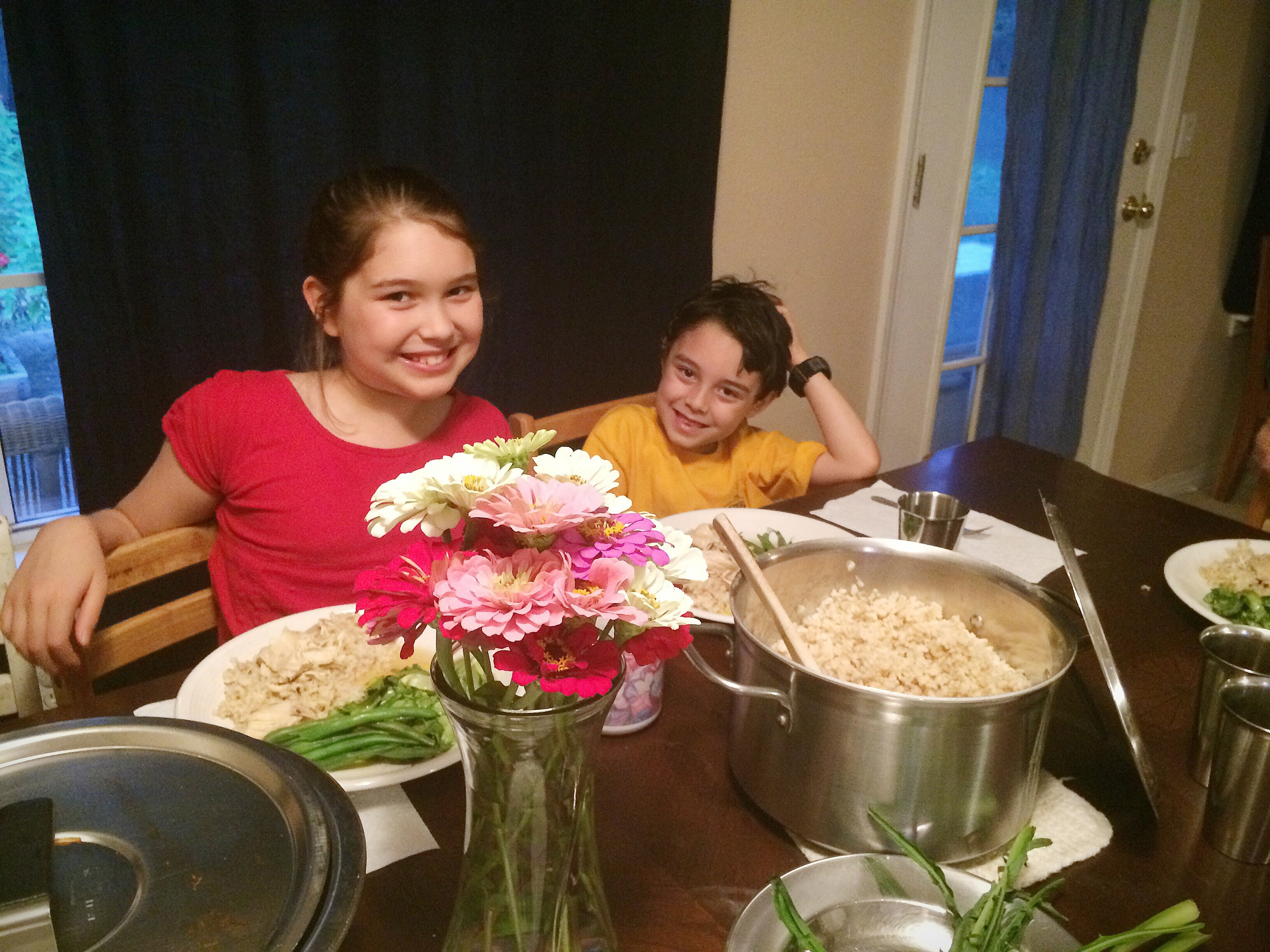 Heistheway and Abraham smile before we eat the organic dinner they and Pelaiah made with delicious real food from scratch