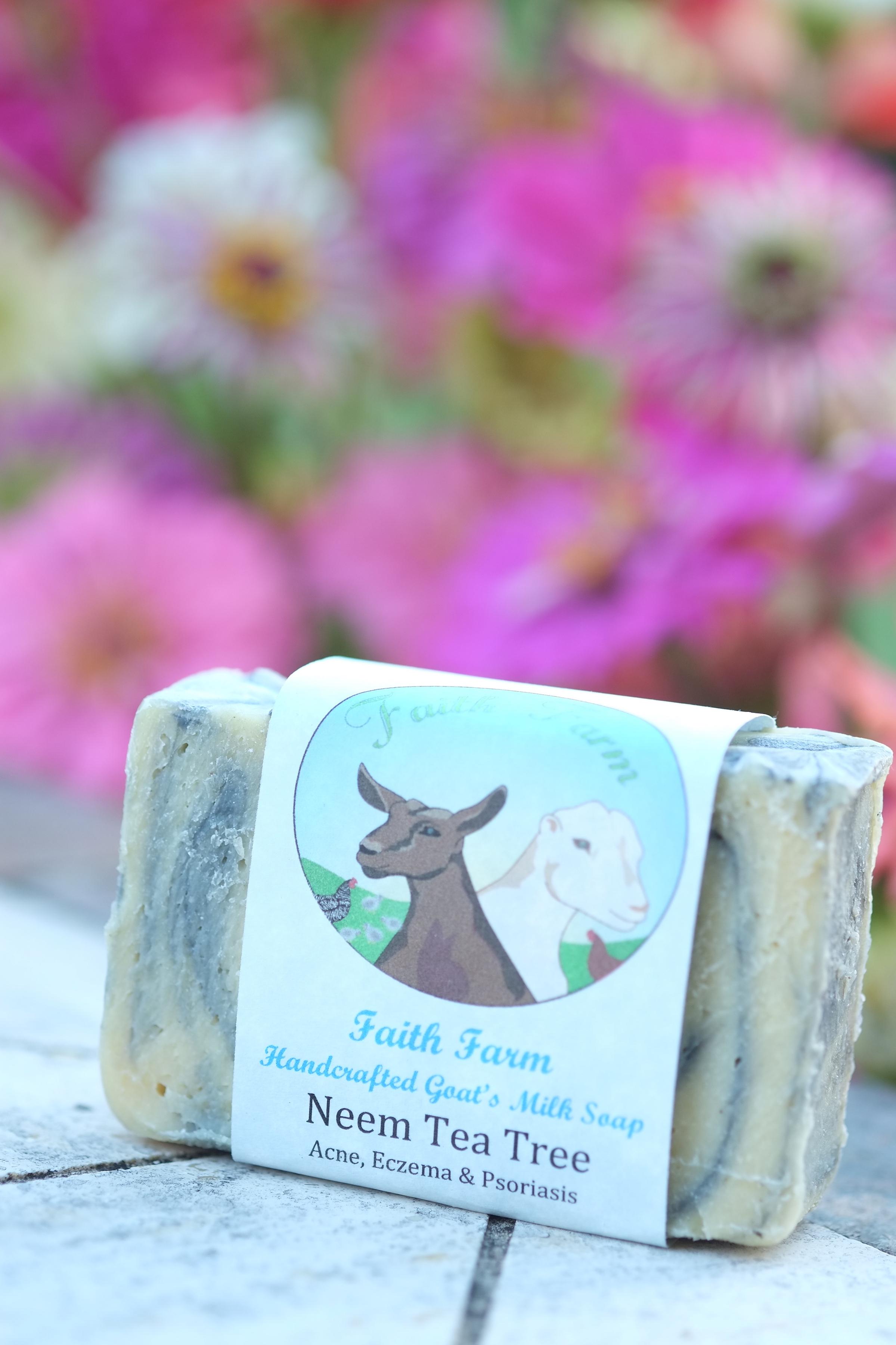 Neem Tea Tree soap bar on table made by Faith Farm