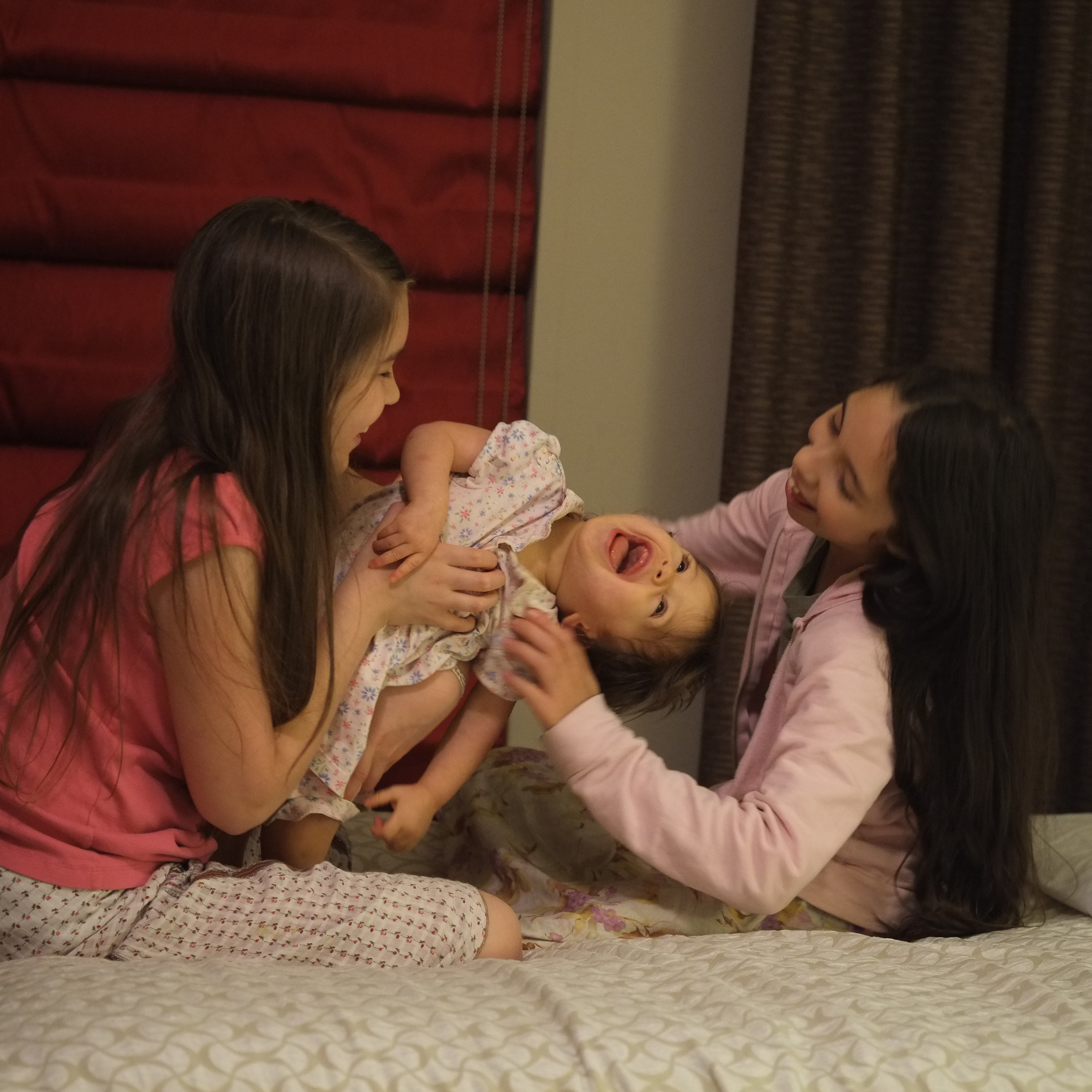 October 2014 - sisters playing together at the hotel as we get ready for another day's journey to make it to another wedding.