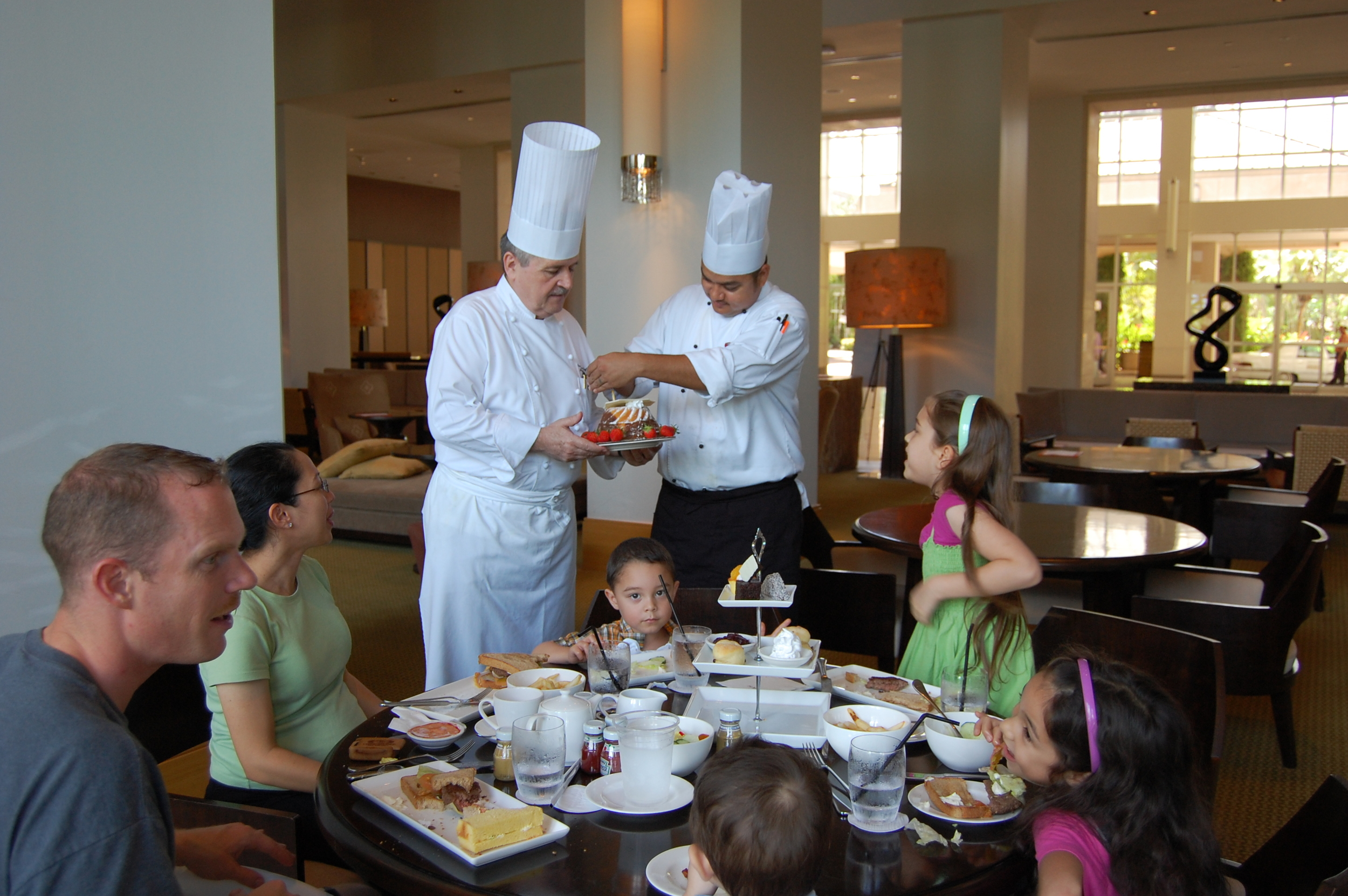 March 2011 - We surprise Pelaiah with high tea and a family meal at Hyatt Regency Guam's lounge and then Famous Executive chef Josef Budde wanted to surprise her with a cake, strawberries, chocolate, and an illusion show for the children. I was also pregnant with Daniel. :-)