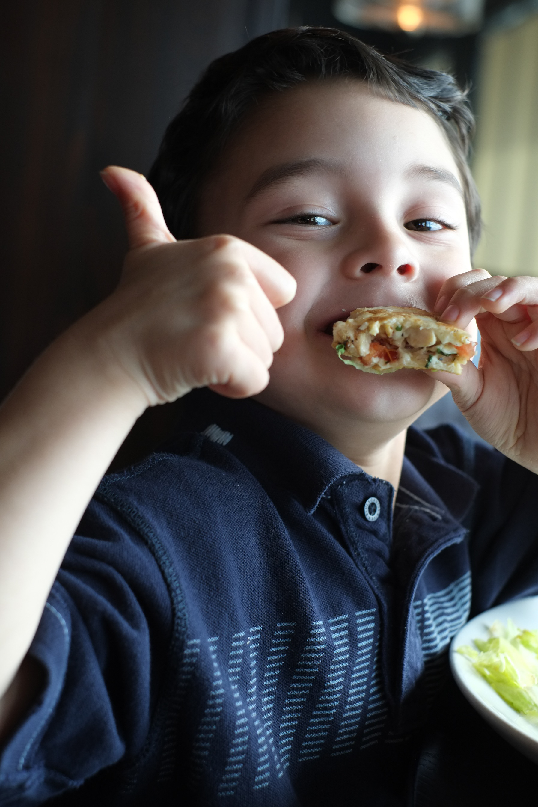 2013 - 5-year-old Abraham enjoying a nice family outing and special treat at the Grand Marlin restaurant in Pensacola.