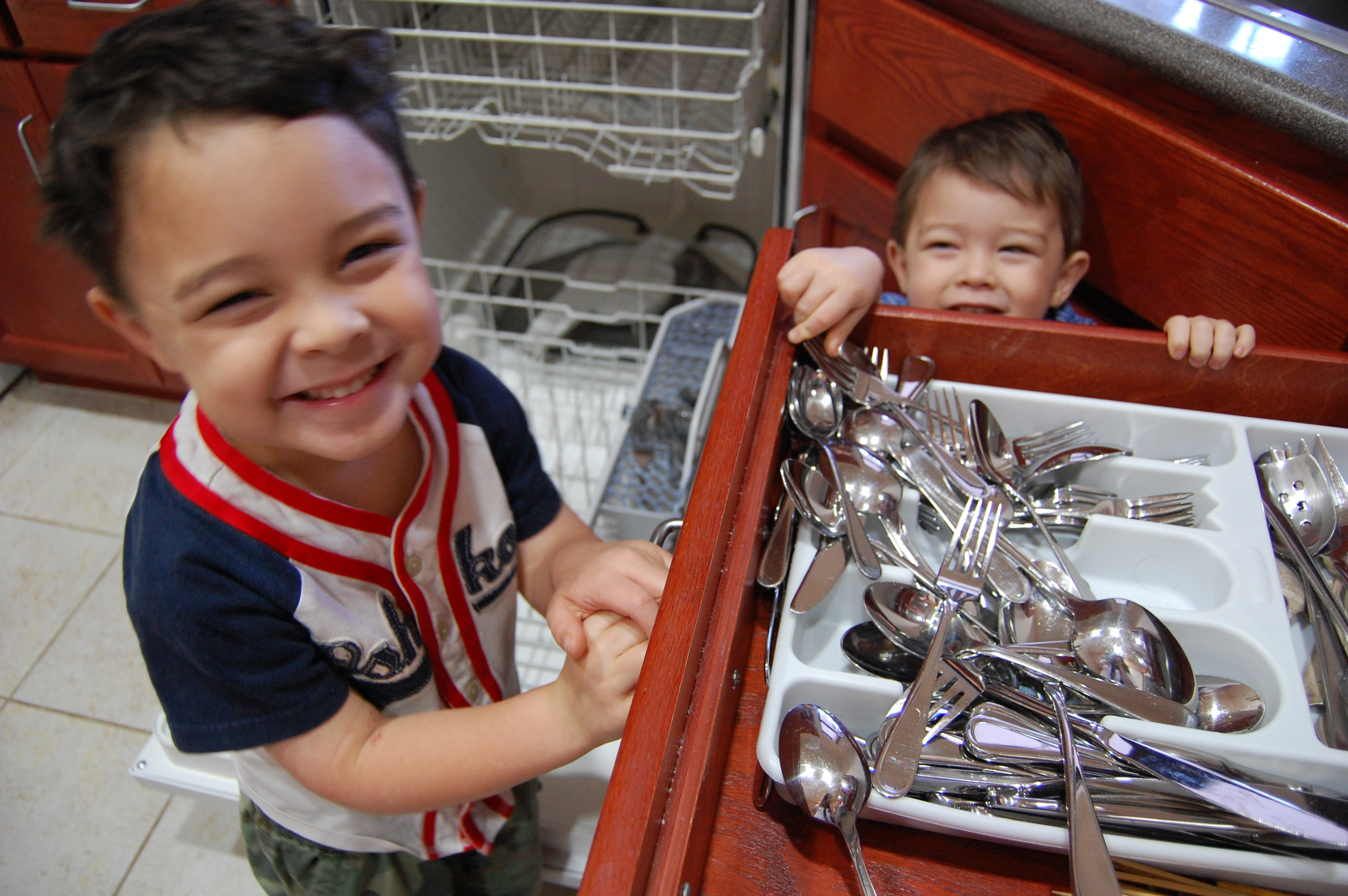 2011 - Abraham (4) and Noah (2) help by putting away the utensils and dishes from the dishwasher. It's a little messy, but at least they're in the correct general area! :) They love helping, and that's the way we like it.