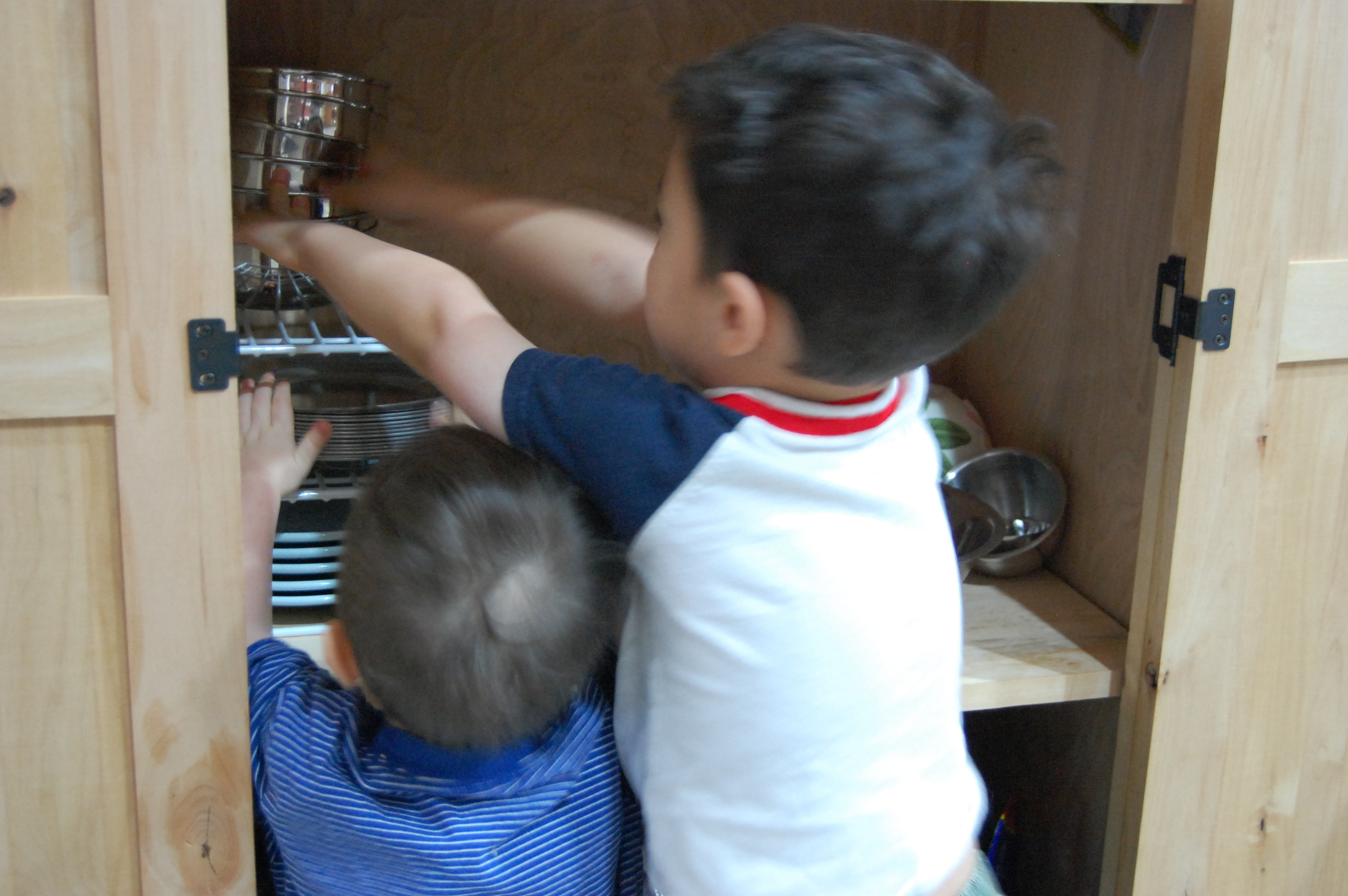 2011  - Noah (2) and Abraham (4) put away our stainless steel plates, bowls, and cups and enjoy stacking them. This was one of their favorite parts of unloading the dishwasher.